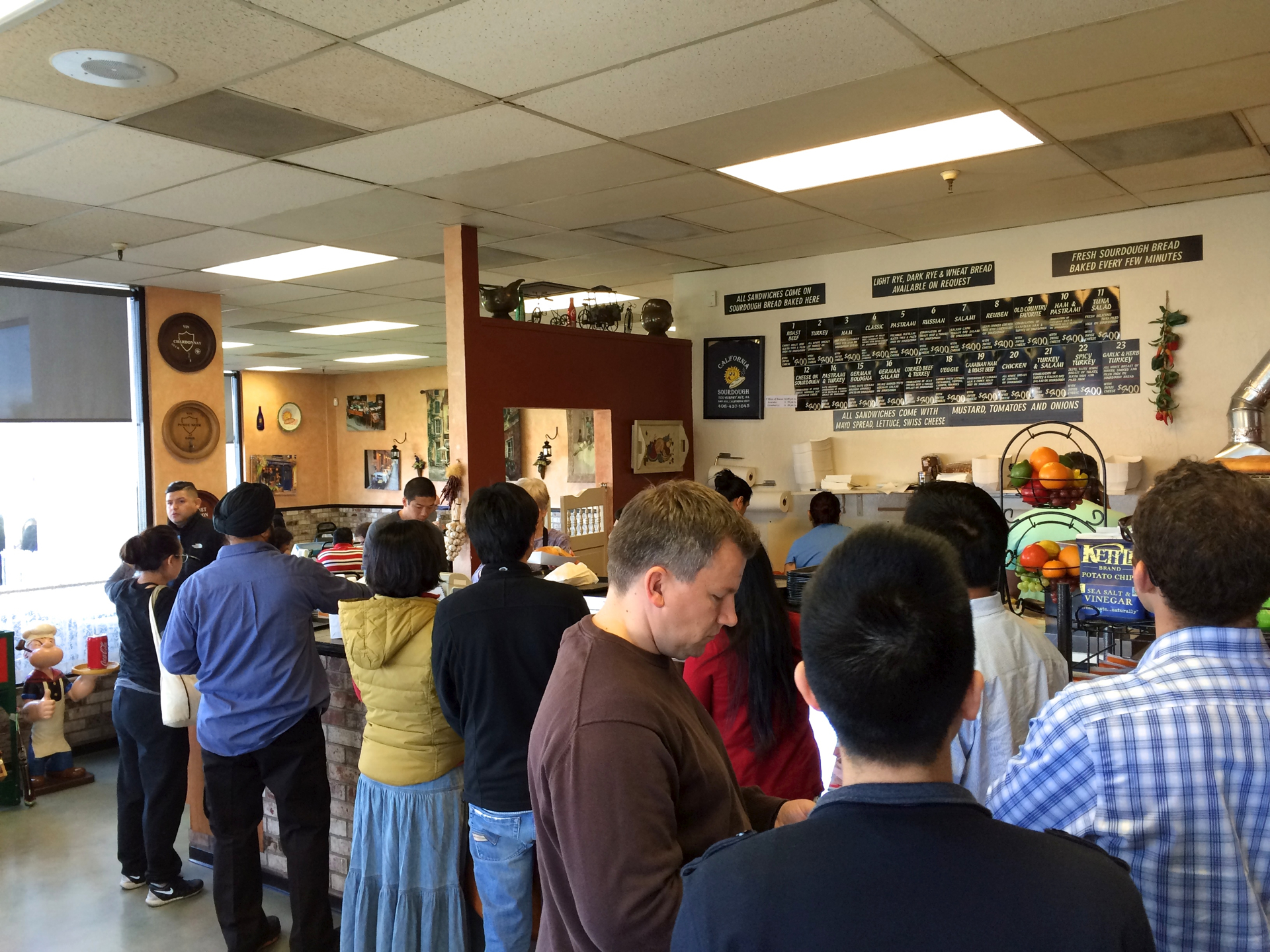 Customers wait to order at California Sourdough in San Jose.