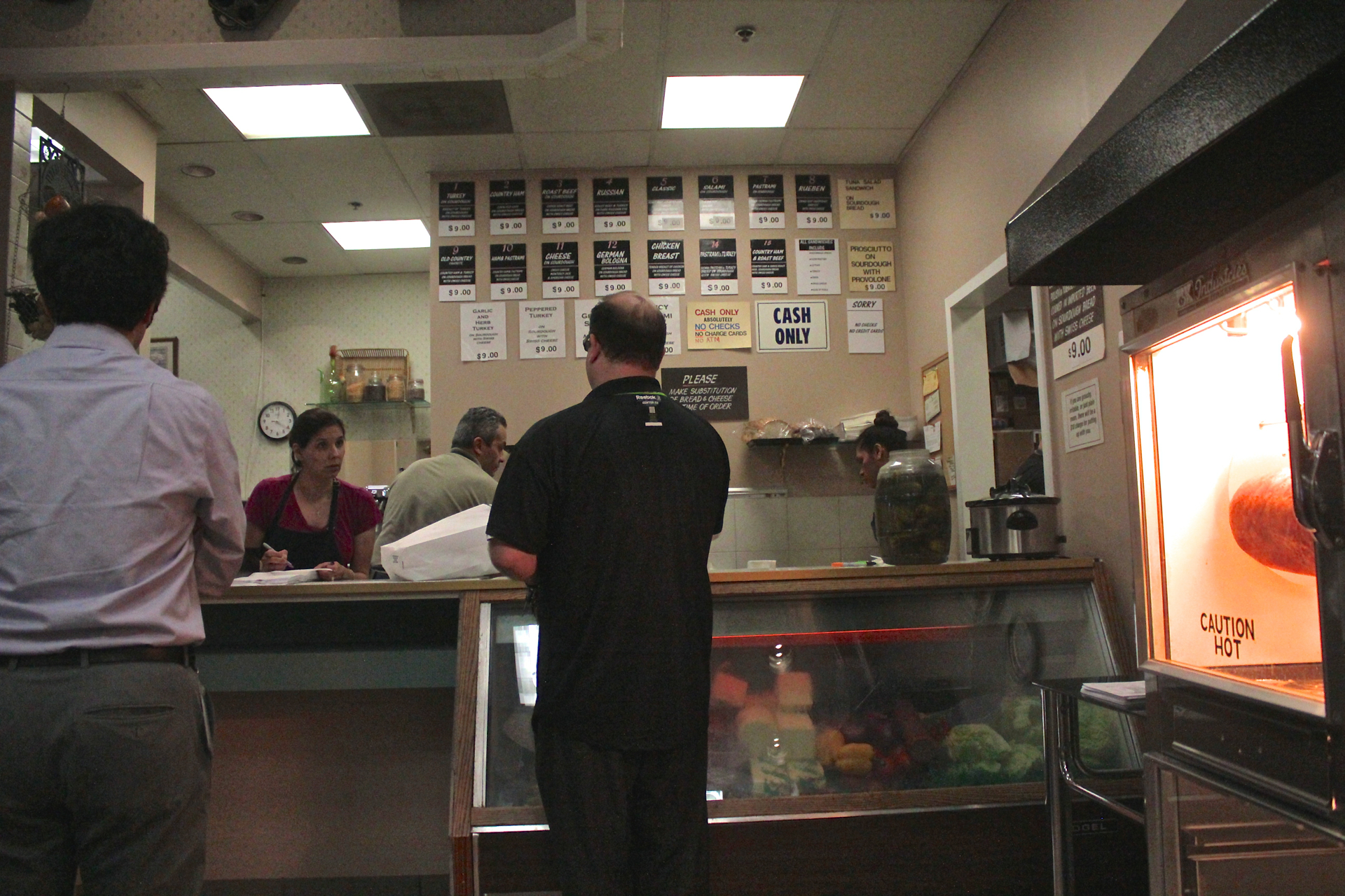 Customers ordering at the counter of Freshly Baked Eatery.