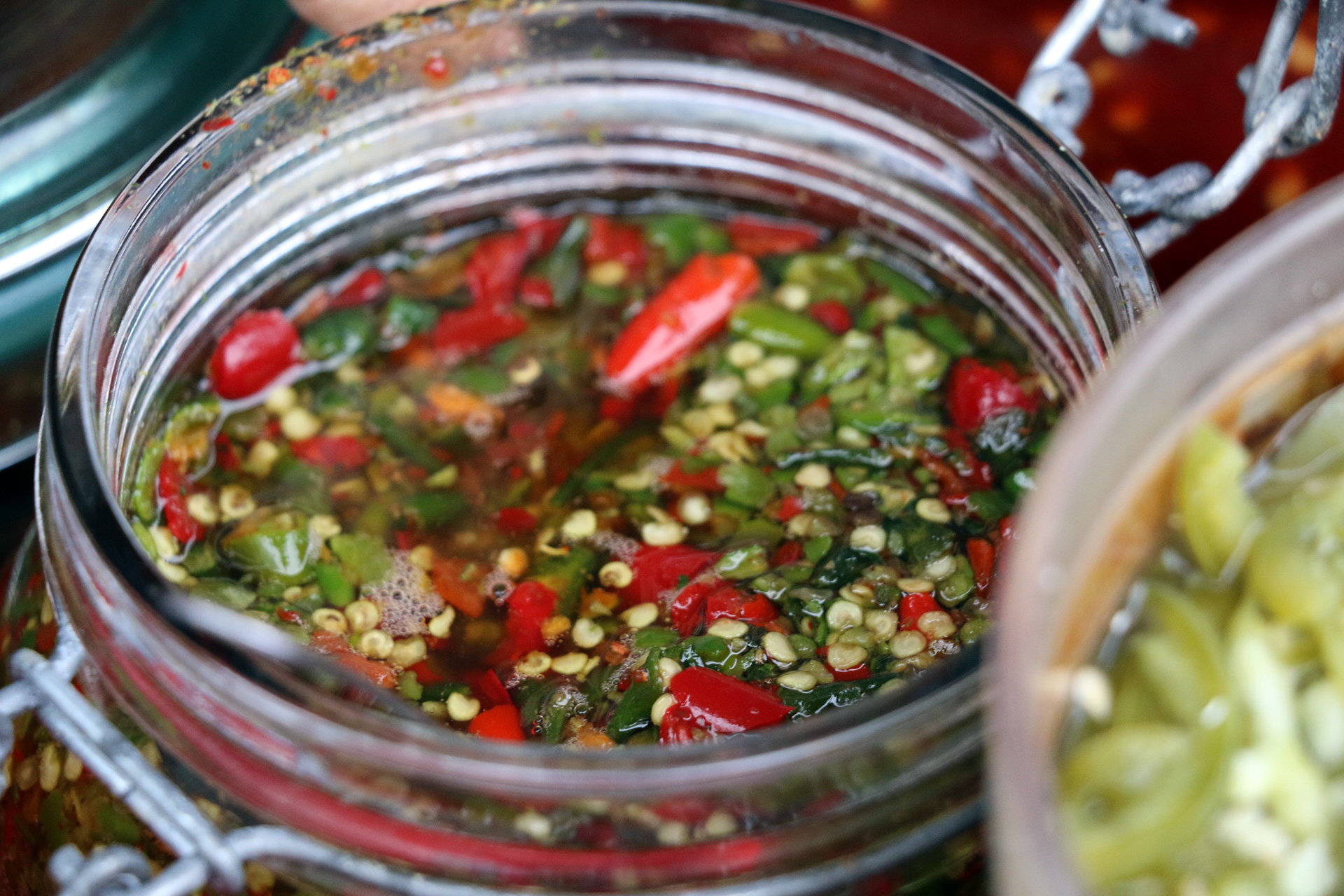 Spicy chili sauce at the condiment bar.