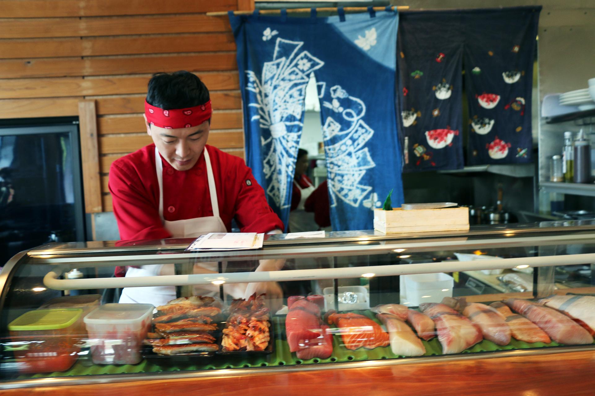 Kiku's small, colorful sushi bar.