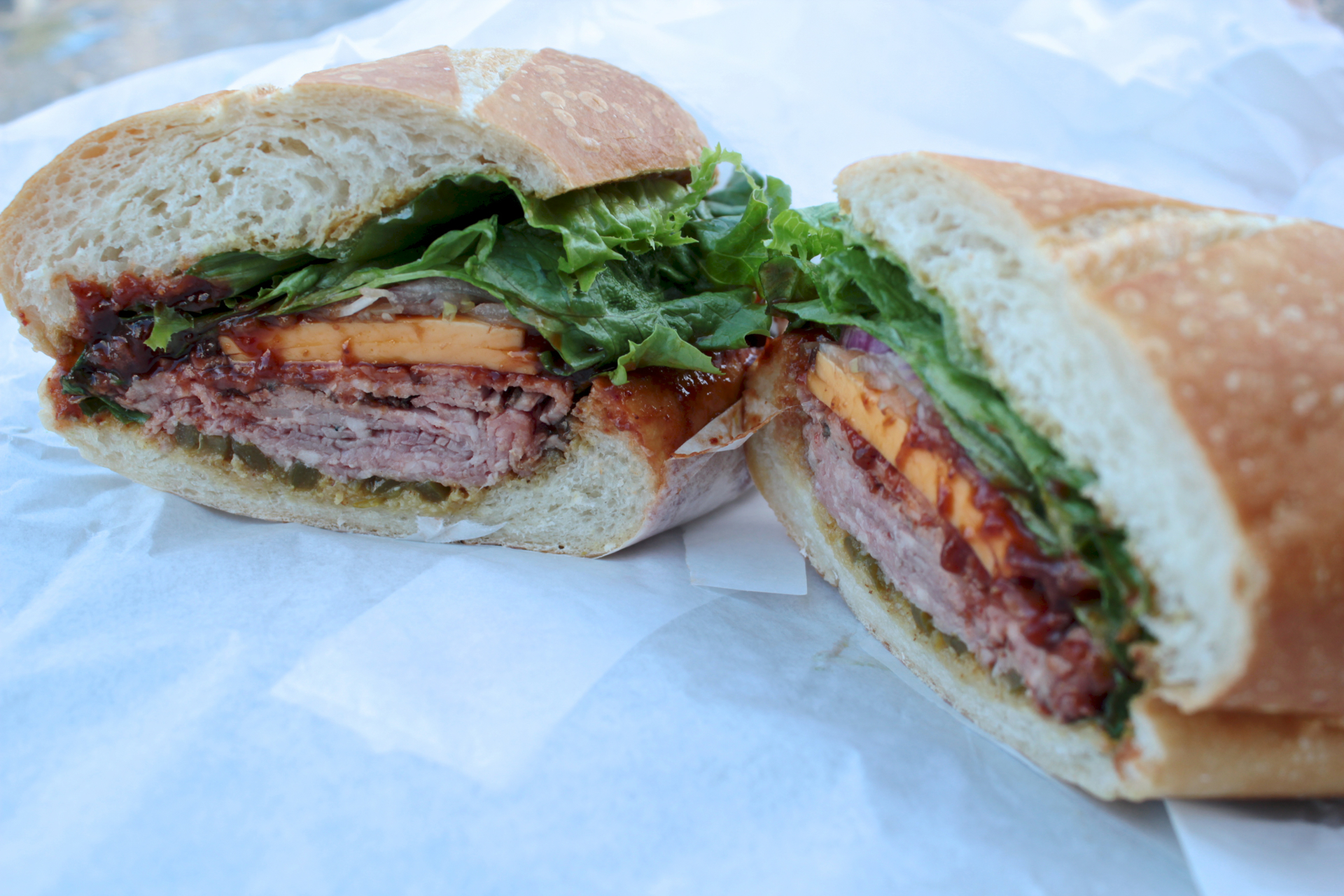 The Slow Burn sandwich features Tri-Tip with chipotle sauce, honey mustard and peppers.