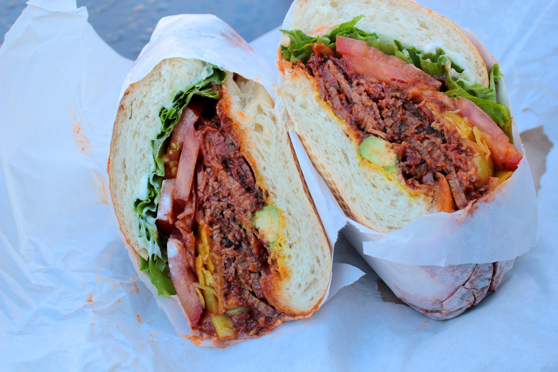 The Super Hero sandwich features Tri-Tip with barbecue sauce, bacon, cheddar cheese and avocado.