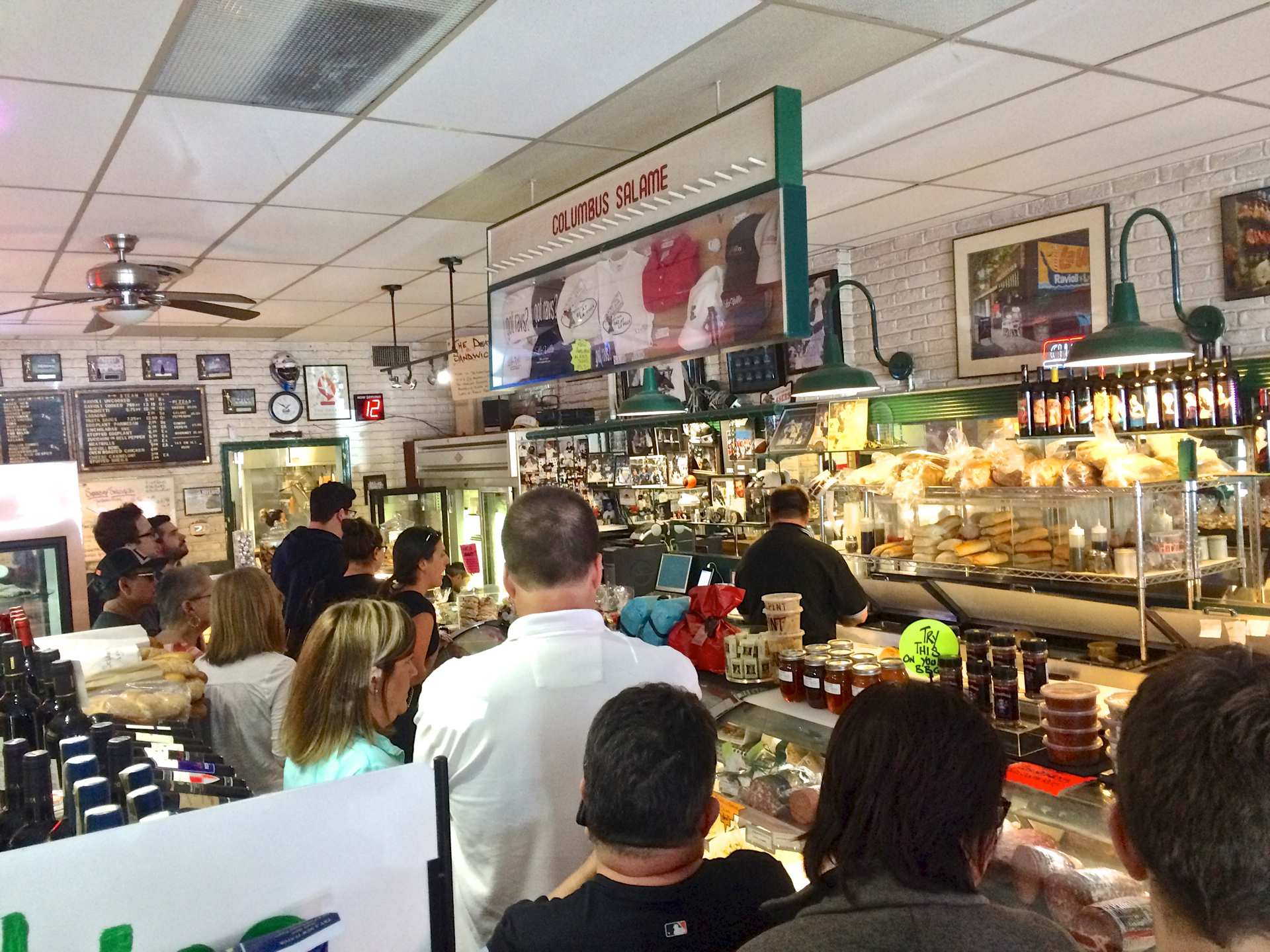 Customers waiting to place orders at Bertucelli's La Villa Gourmet.