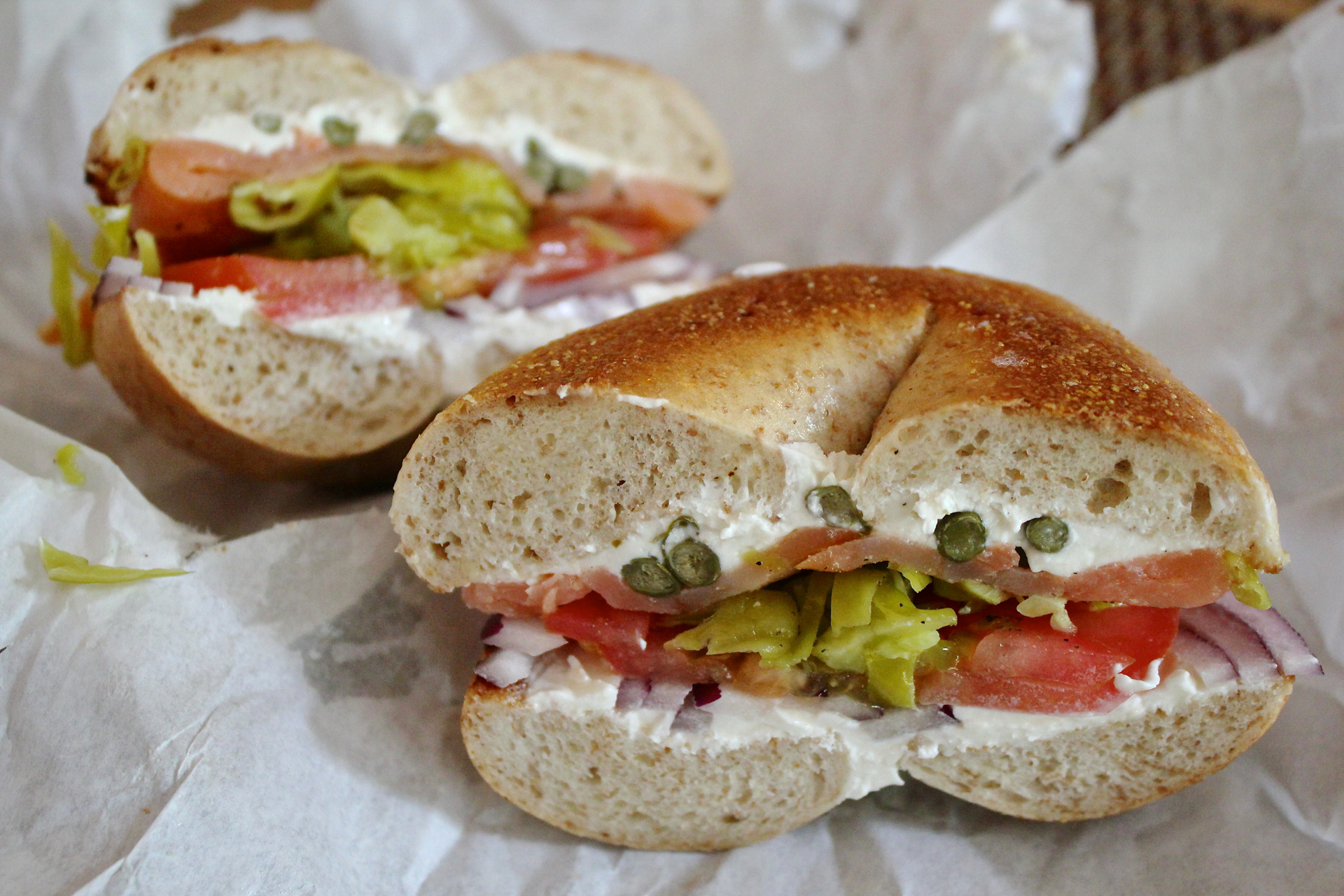 A peppered lox bagel sandwich on a whole wheat bagel from Regal Bagel.