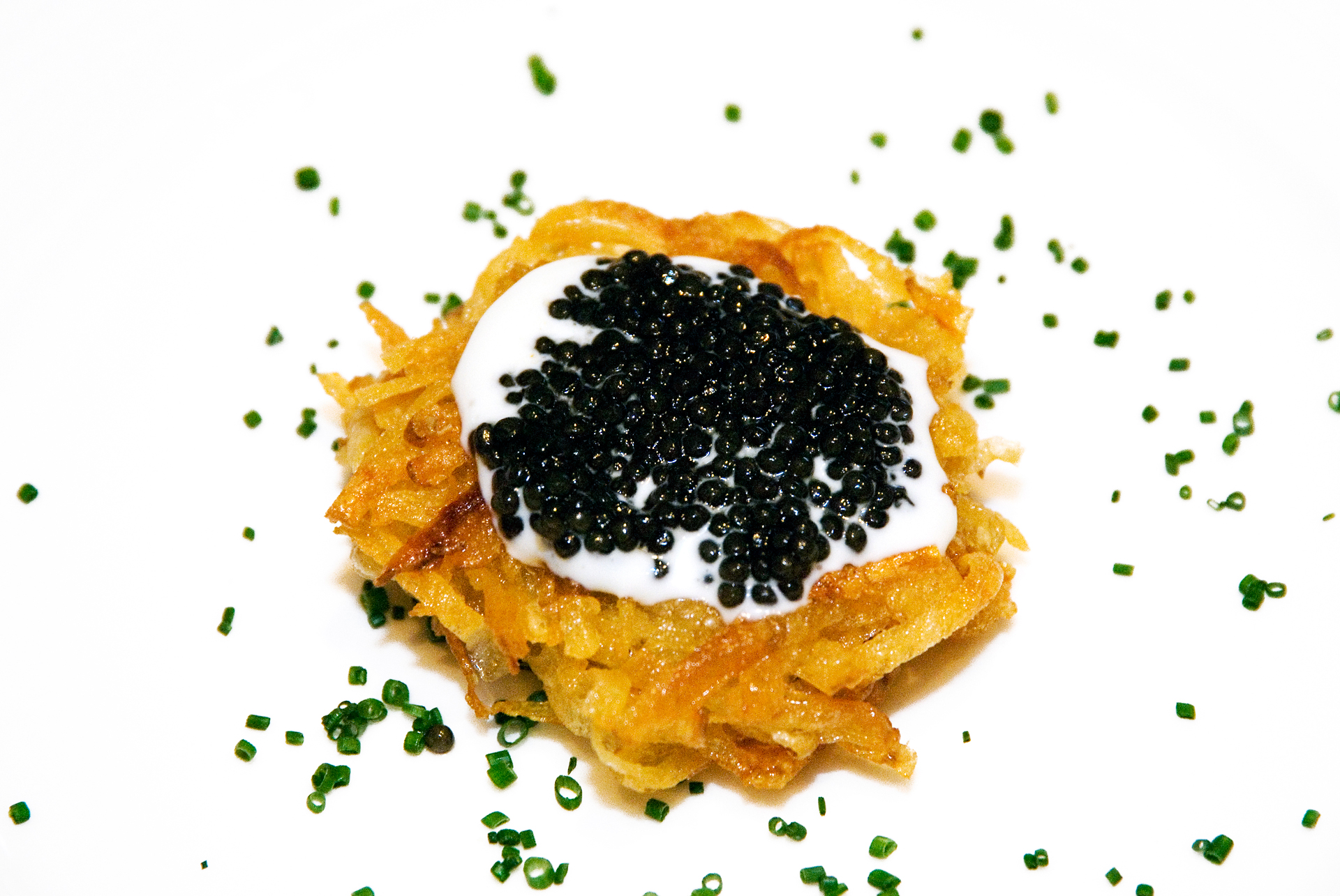 Crisp Rosti Potato with creme fraiche and caviar.