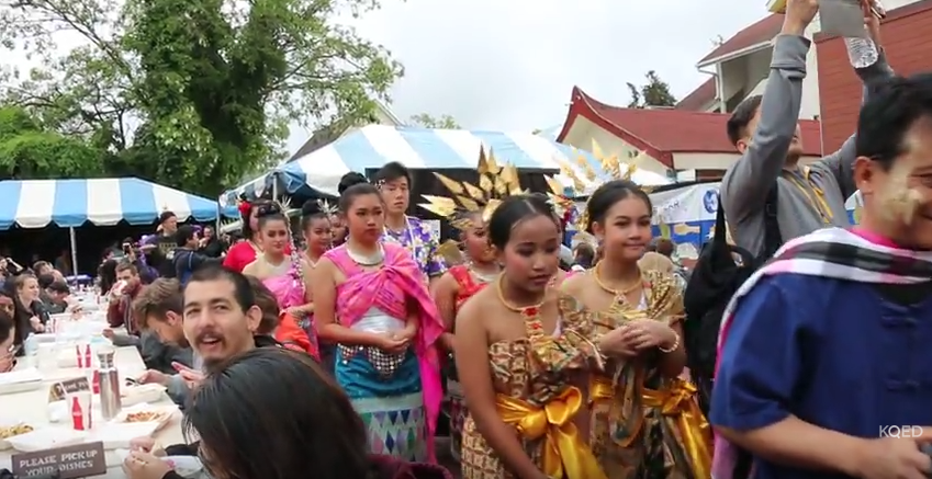 Congregants of Wat Mongkolratanaram begin the Songkran celebration with a processional leading to the performance area.
