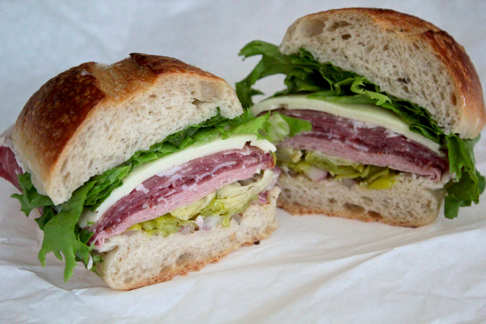 The Godfather sandwich features salami, coppa, prosciutto, mortadella, artichoke hearts and pepperoncinis.