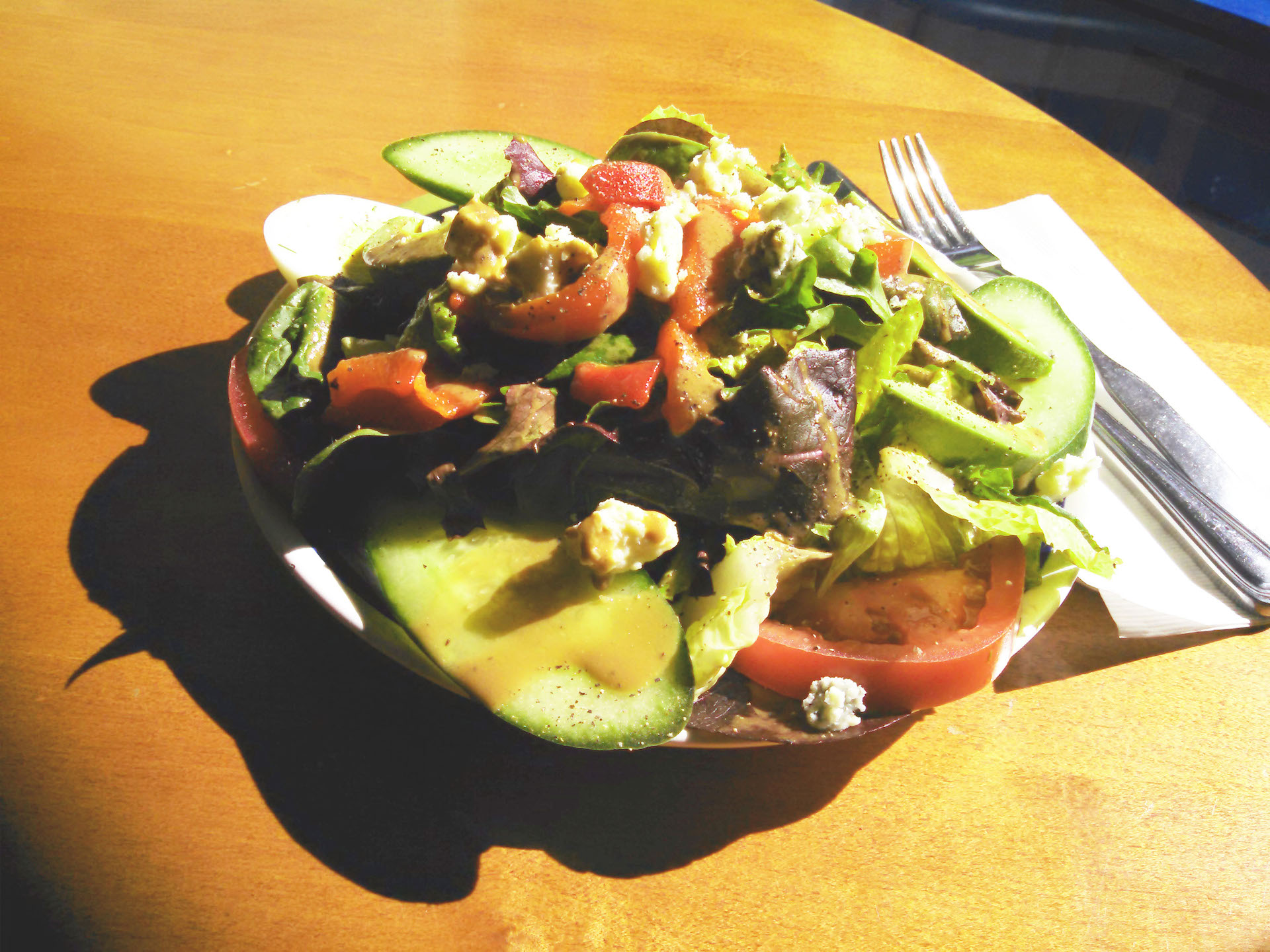The Maison salad in the setting sunlight