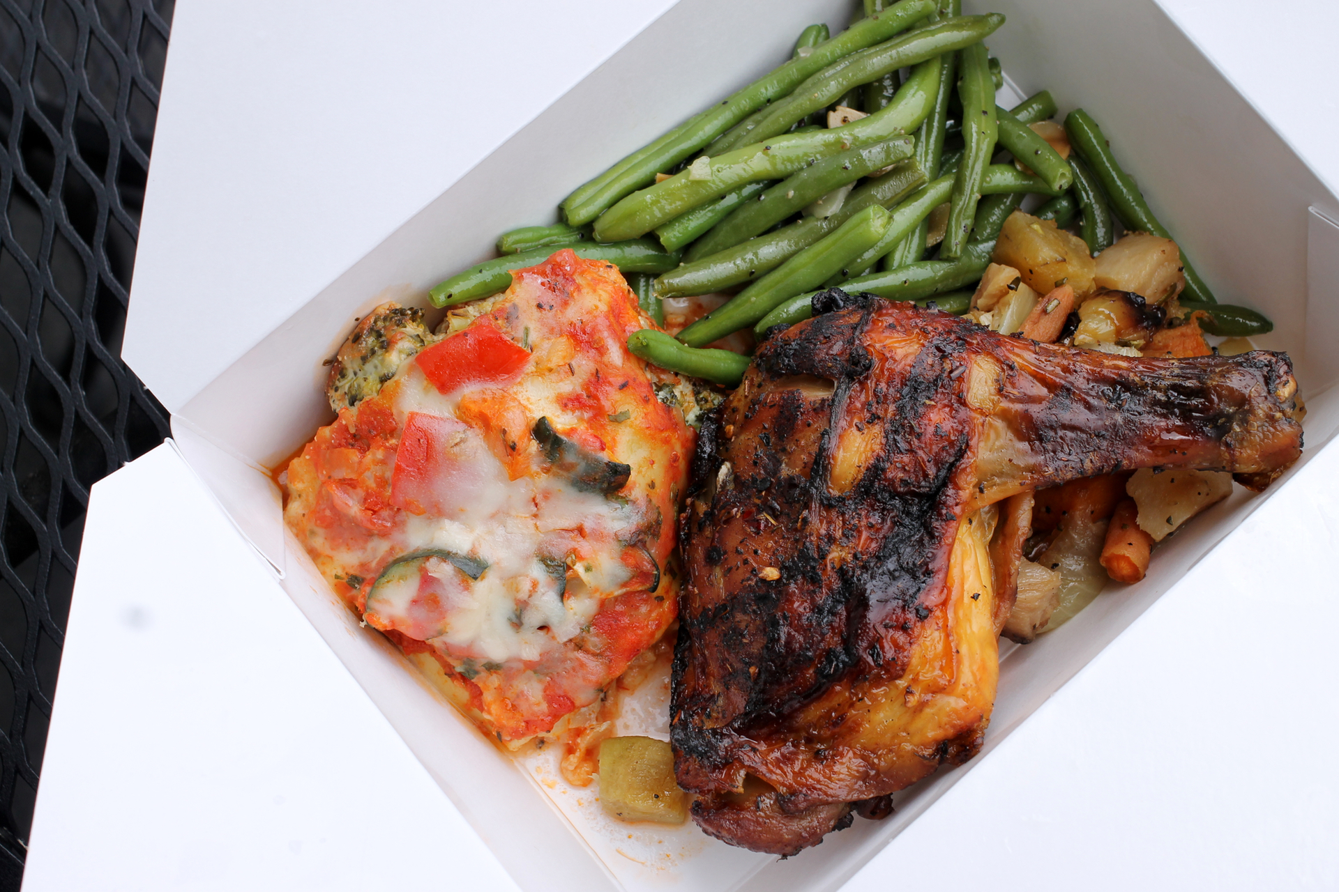 Vegetable lasagna, green beans almondine, roasted root vegetables, and jerk chicken from Piedmont Grocery.