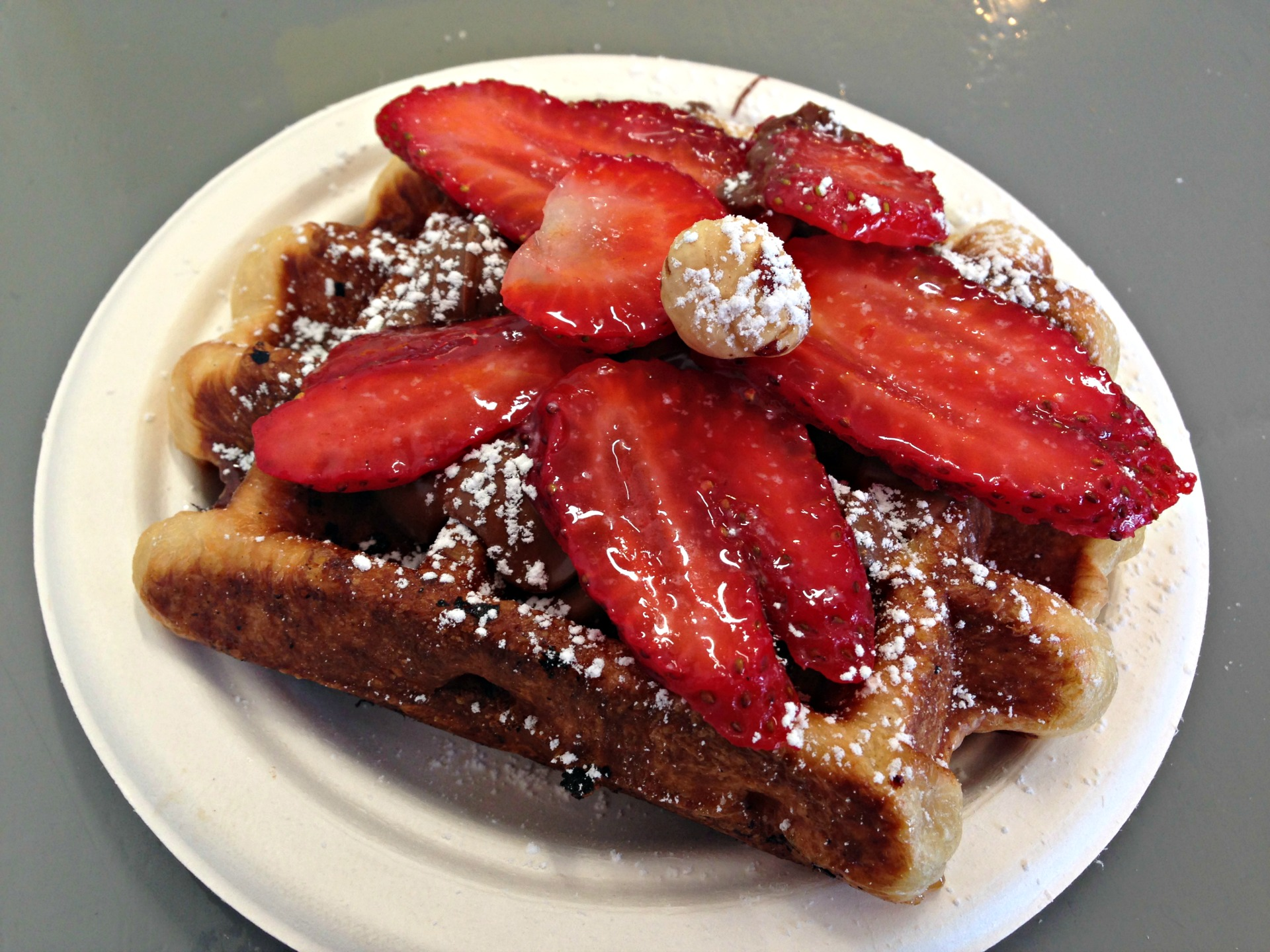 A Nutella and strawberry topped liege waffle at at Little Gem Belgian Waffles.
