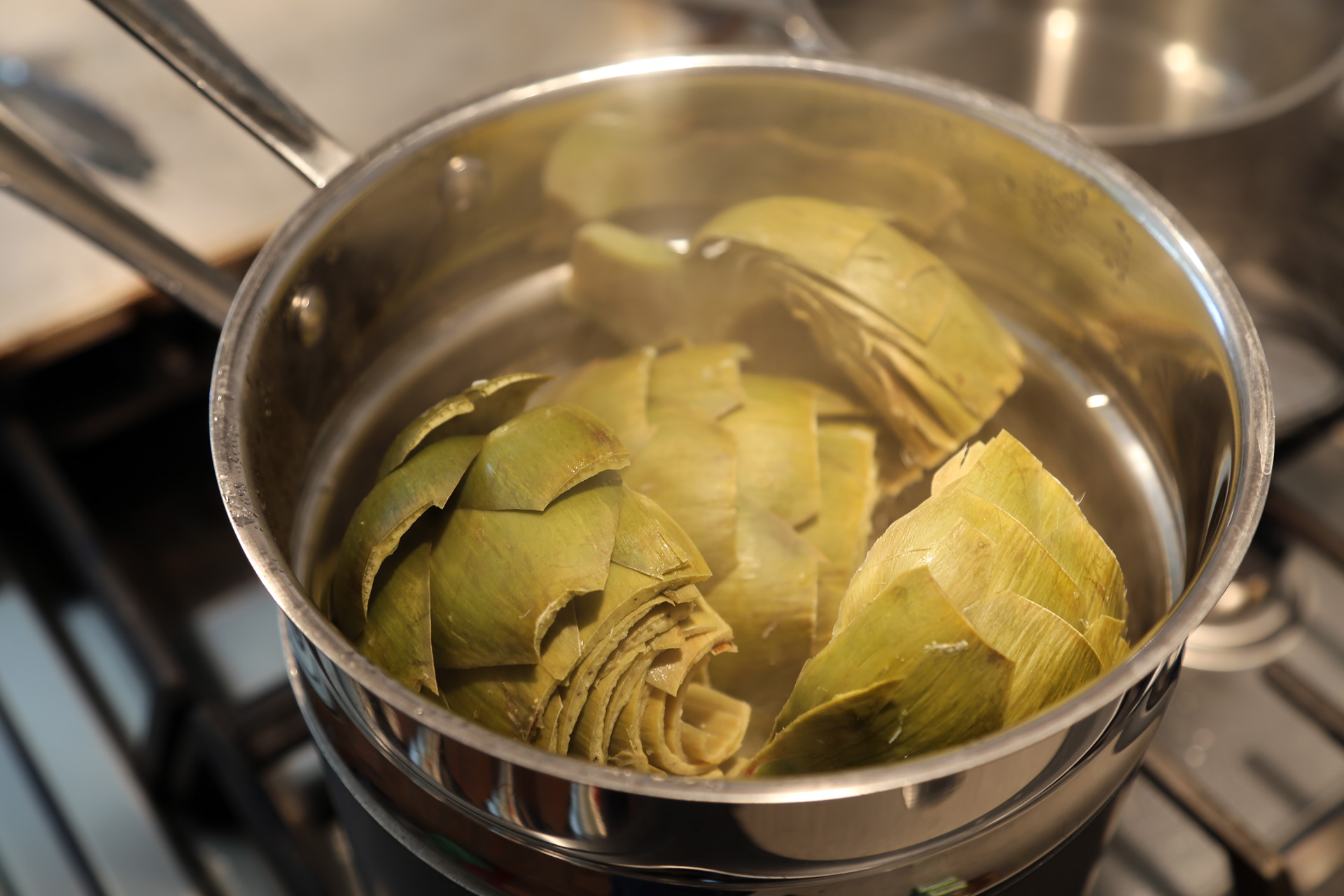 Cover and steam until the heart of the artichoke and the stem is tender when pierced with a paring knife, about 20 minutes.