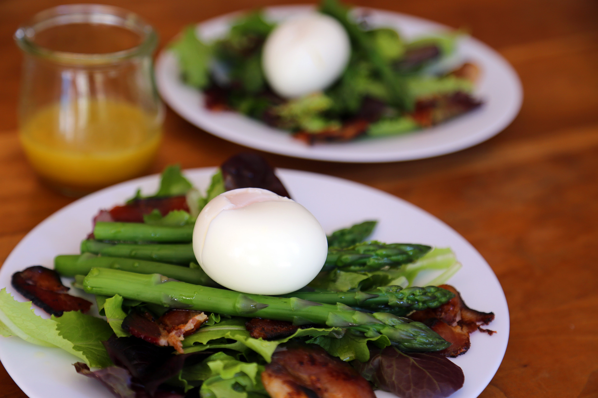 Toss to coat with vinaigrette, then divide between individual plates. Place an egg on each salad.
