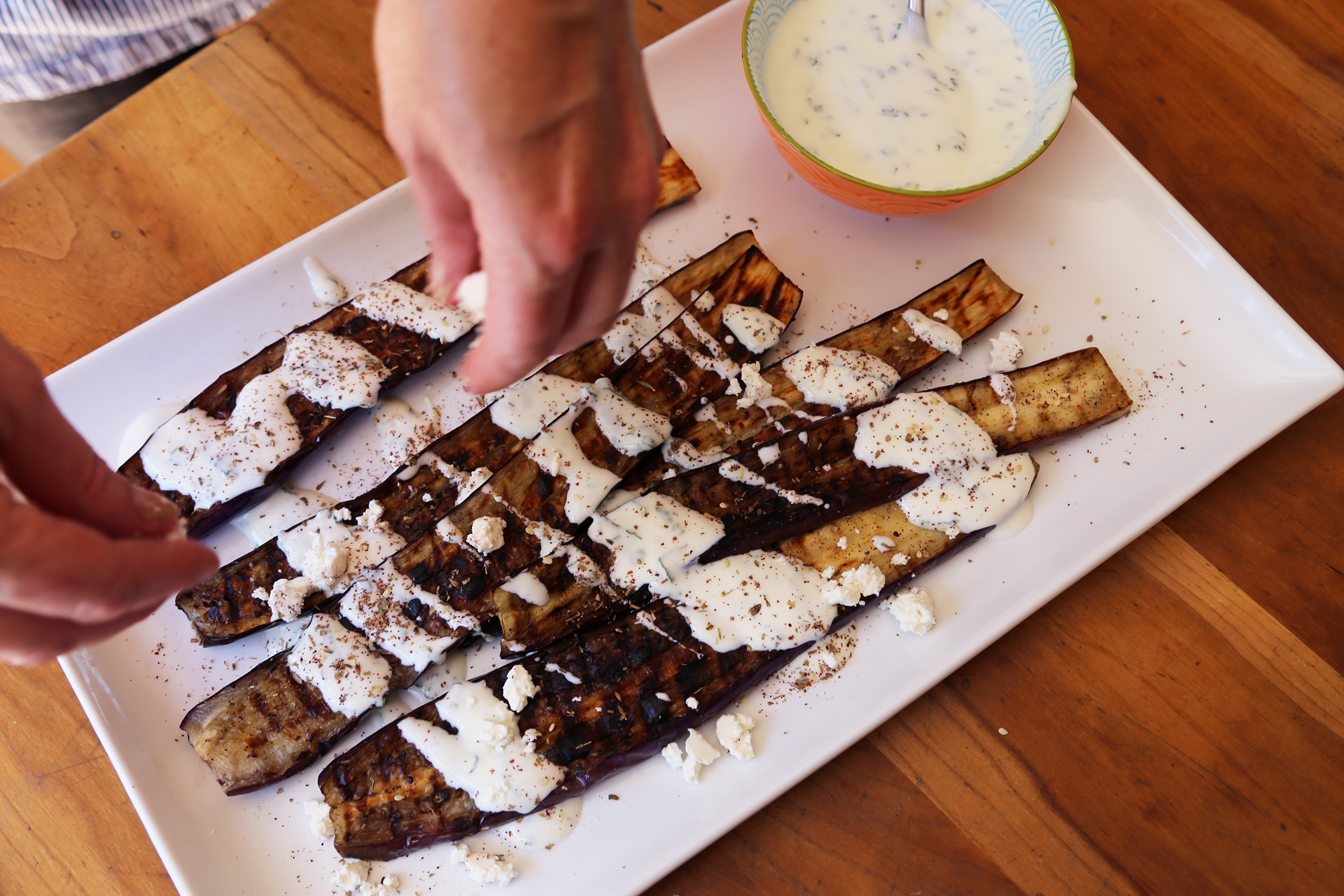 Transfer to a serving plate. Drizzle the eggplant with the yogurt sauce, then sprinkle with the feta and za'atar. Serve.