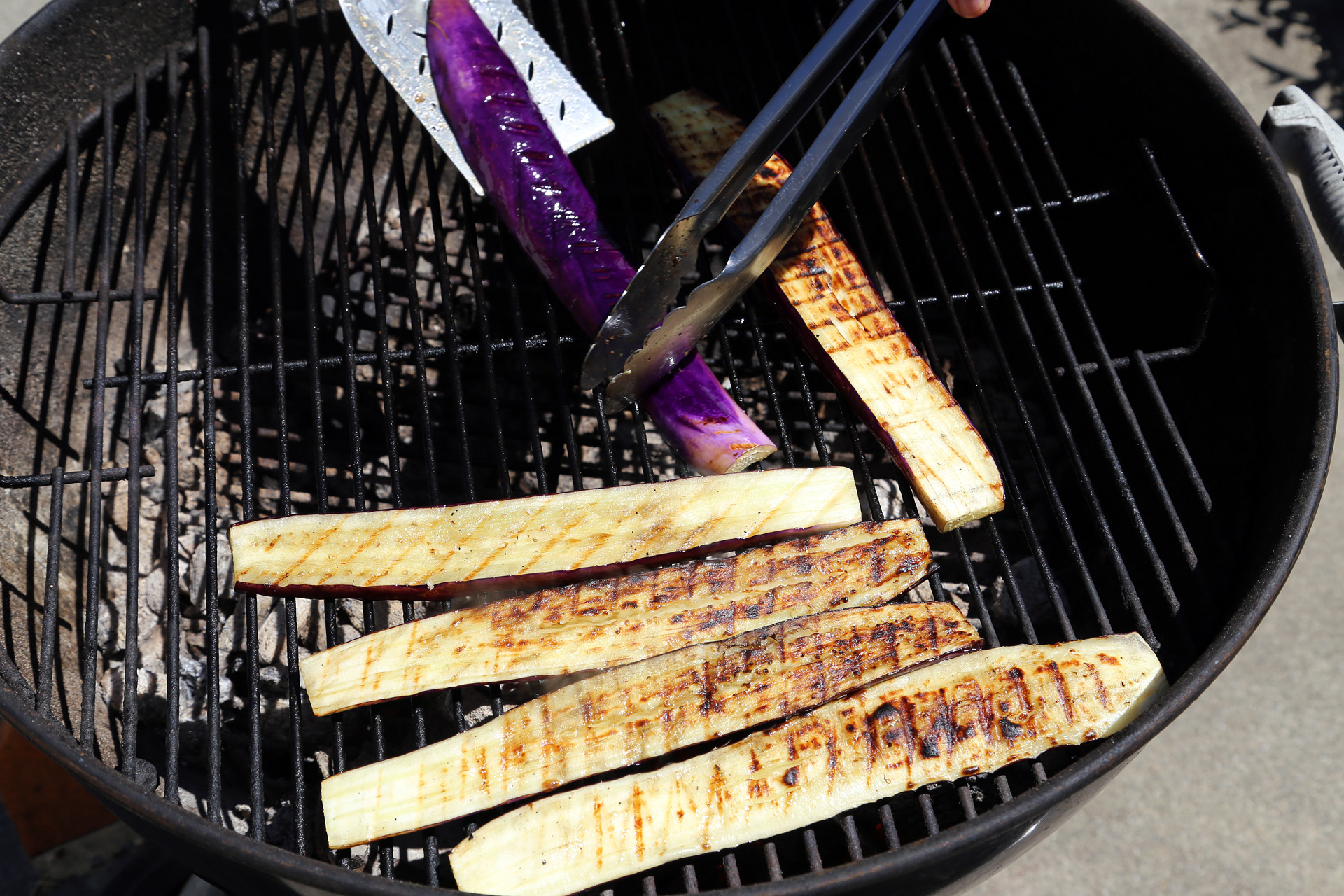 Place the eggplant slices over the heat in a single layer and grill, turning once, until tender and there are dark grill marks.