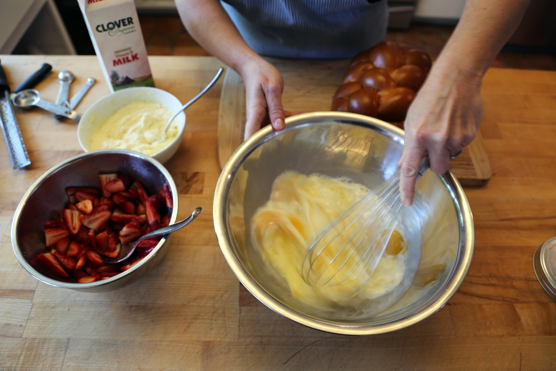 In a large shallow bowl, whisk together the eggs, milk, vanilla extract, and a pinch of salt.