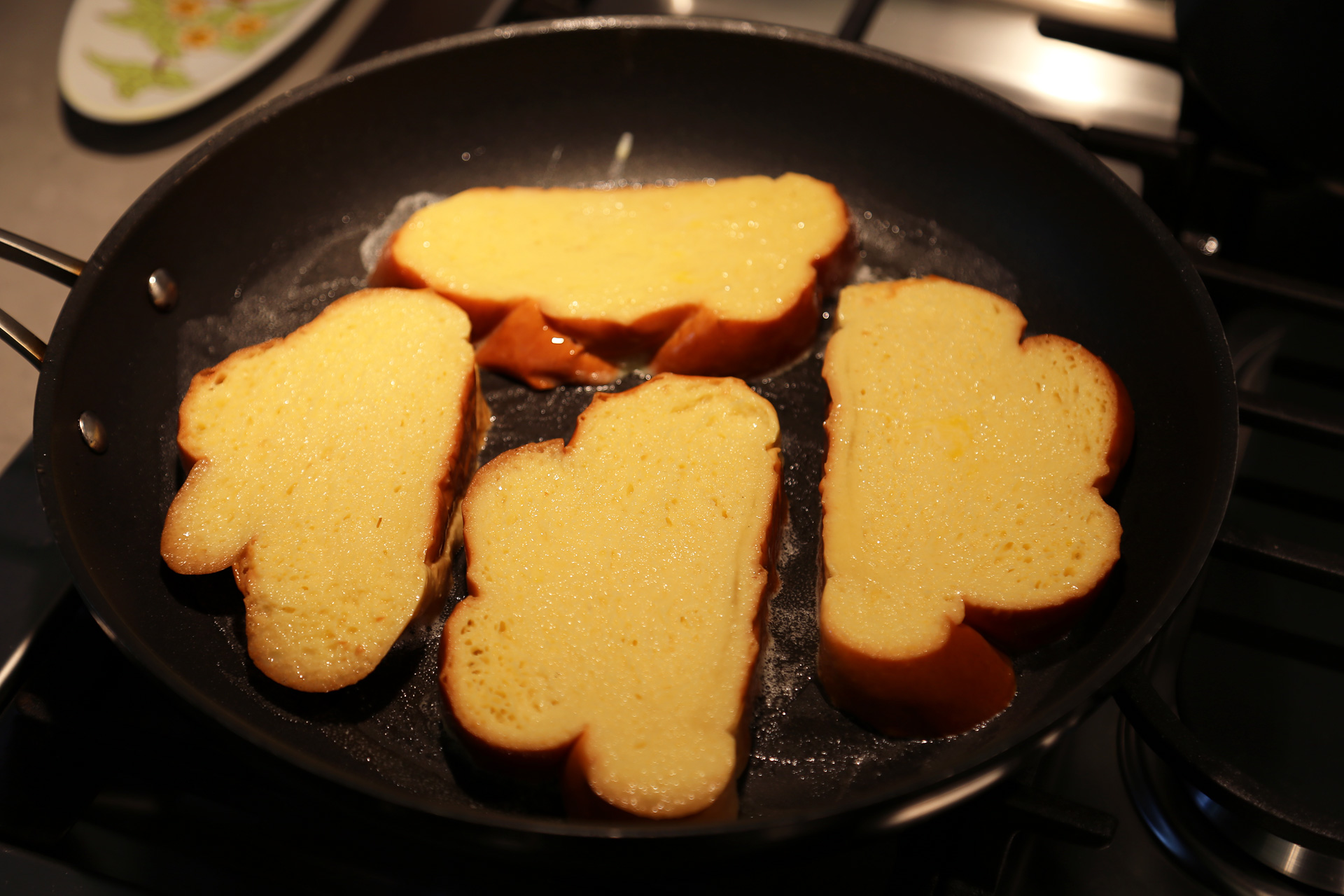 Add as many bread slices as you can easily fit into each pan or on the griddle.