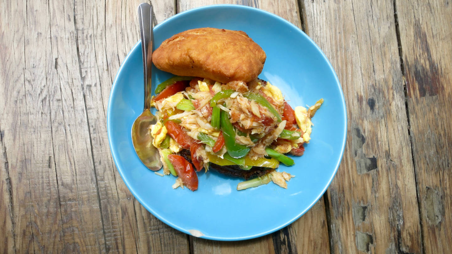 "Miss Oliie's spicy salt fish and ackee comes with sweet plantains and a large ""bake"", or fried dough, that you can use to soak up the juices from your meal. Jenny Oh"