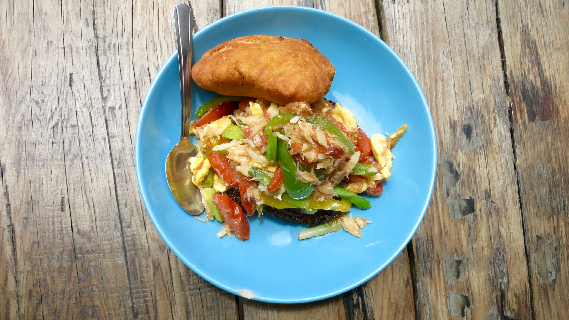 "Miss Oliie's spicy salt fish and ackee comes with sweet plantains and a large ""bake"", or fried dough, that you can use to soak up the juices from your meal."