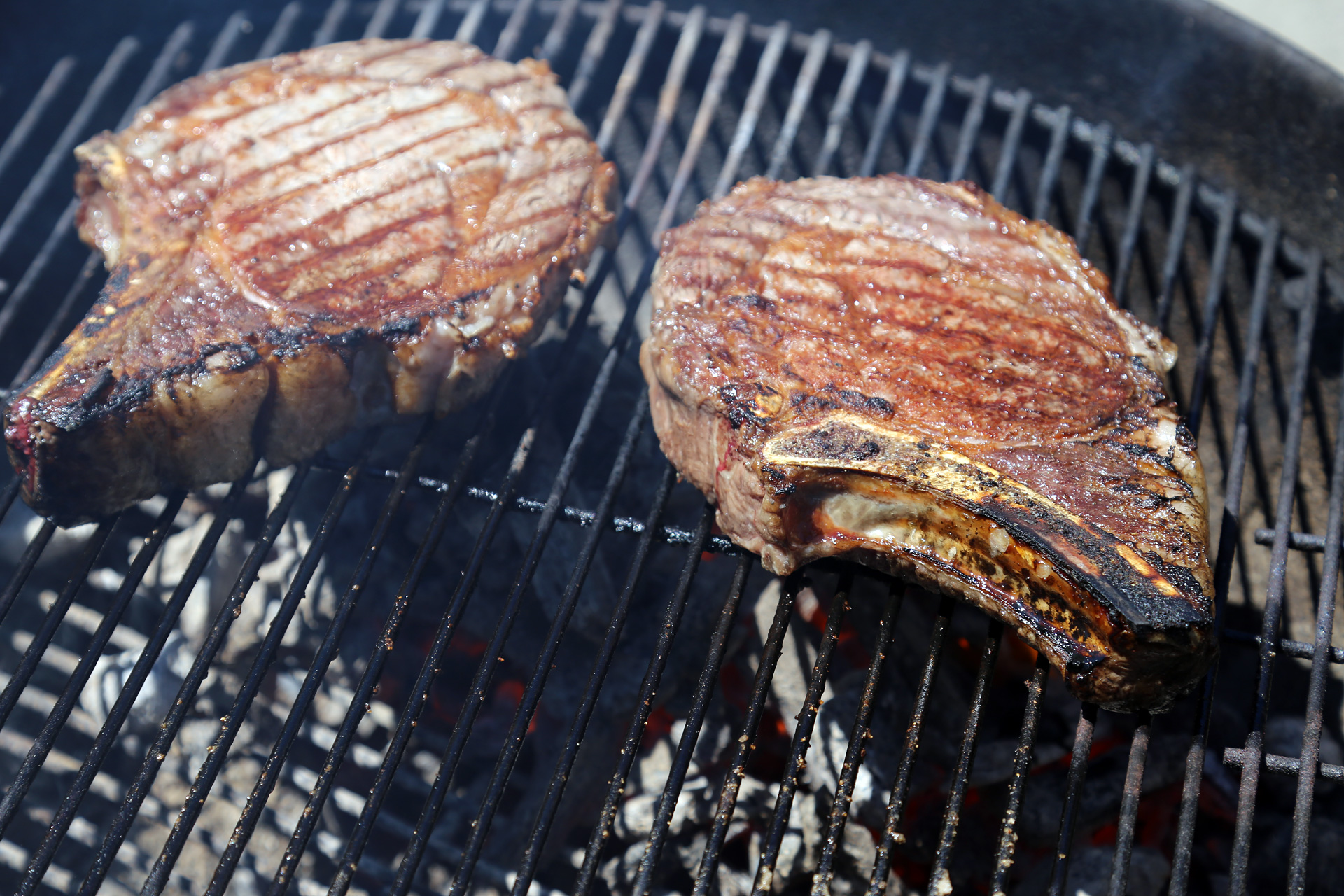 Sear the steak over the hot fire until a nice char forms on the exterior, turning occasionally.