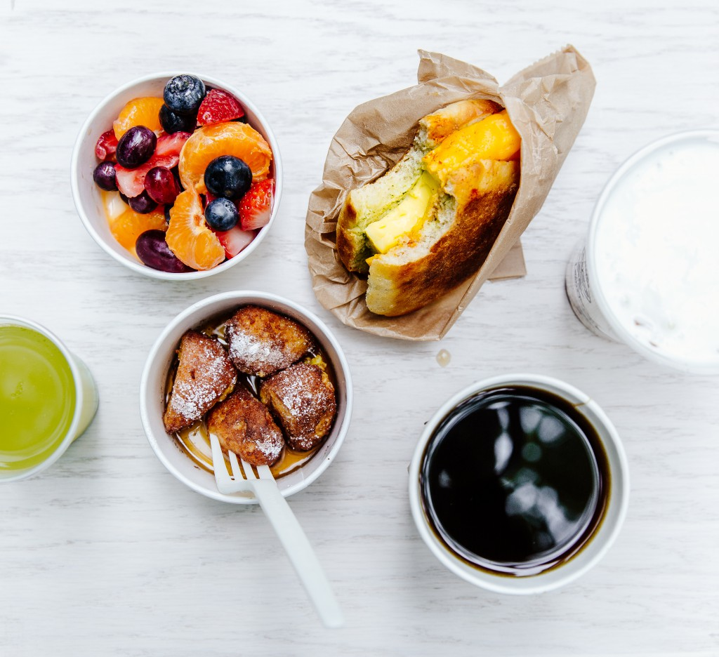 Brekkie Egg in the Hole, French Toast Holes, Yogurt and Granola, Fresh Fruit, Coffee, and Green Juice.