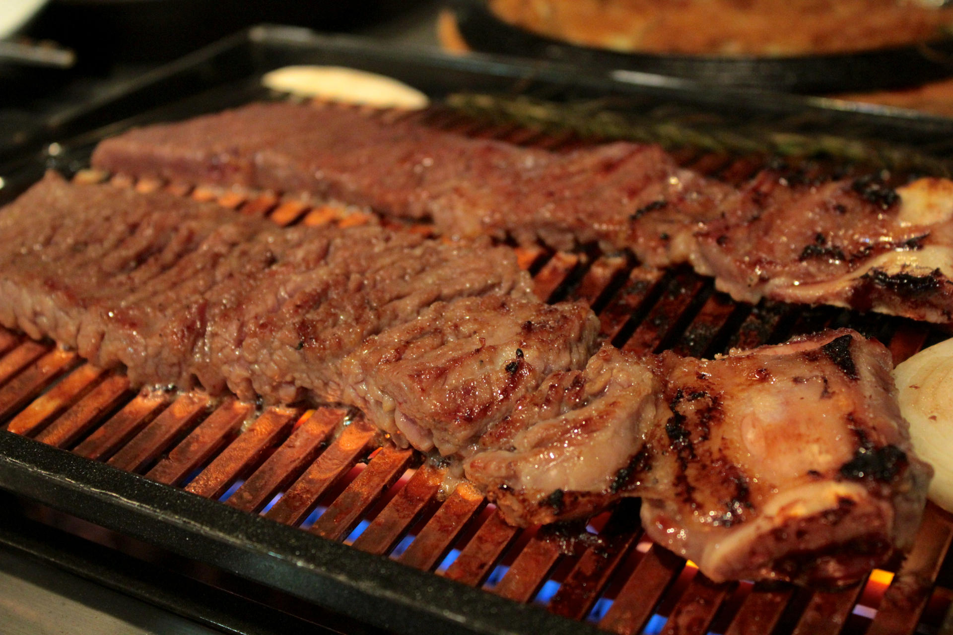 Marinated beef short rib on on the grill at Chungdam.