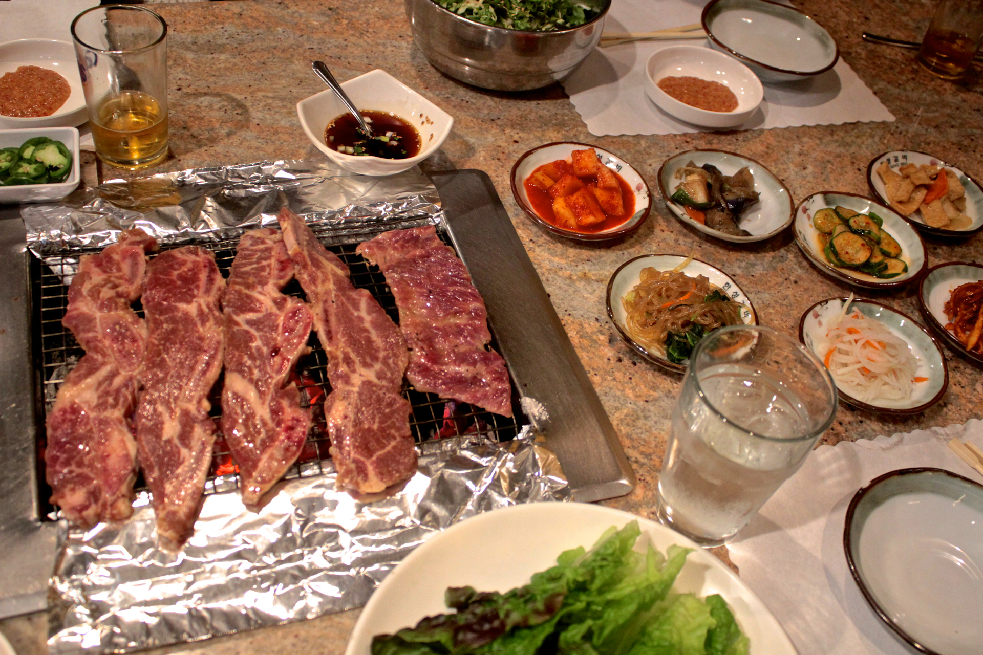 Short ribs cooking on the charcoal grill at Han Sung.