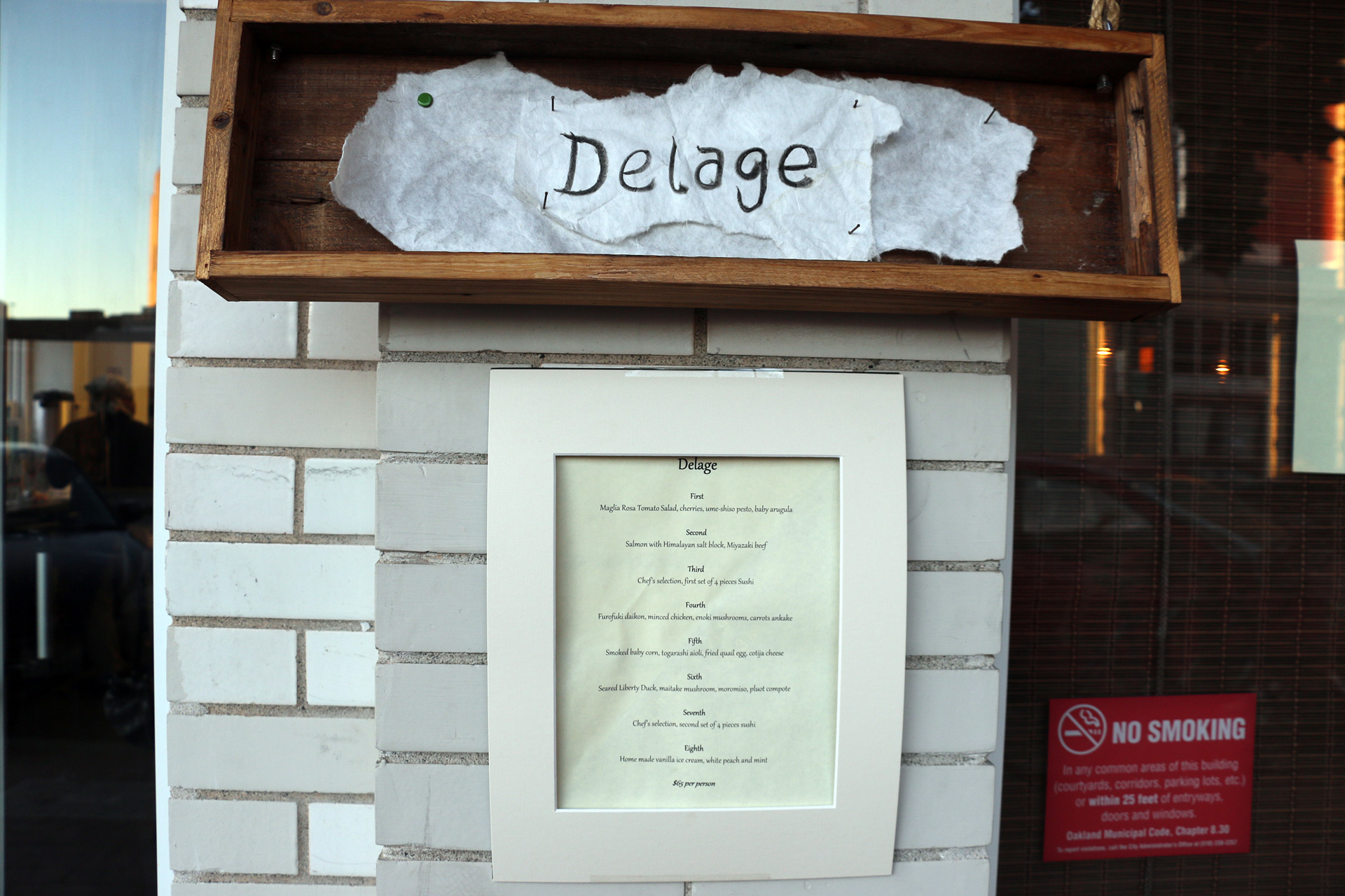 The nightly menu on display outside Delage.