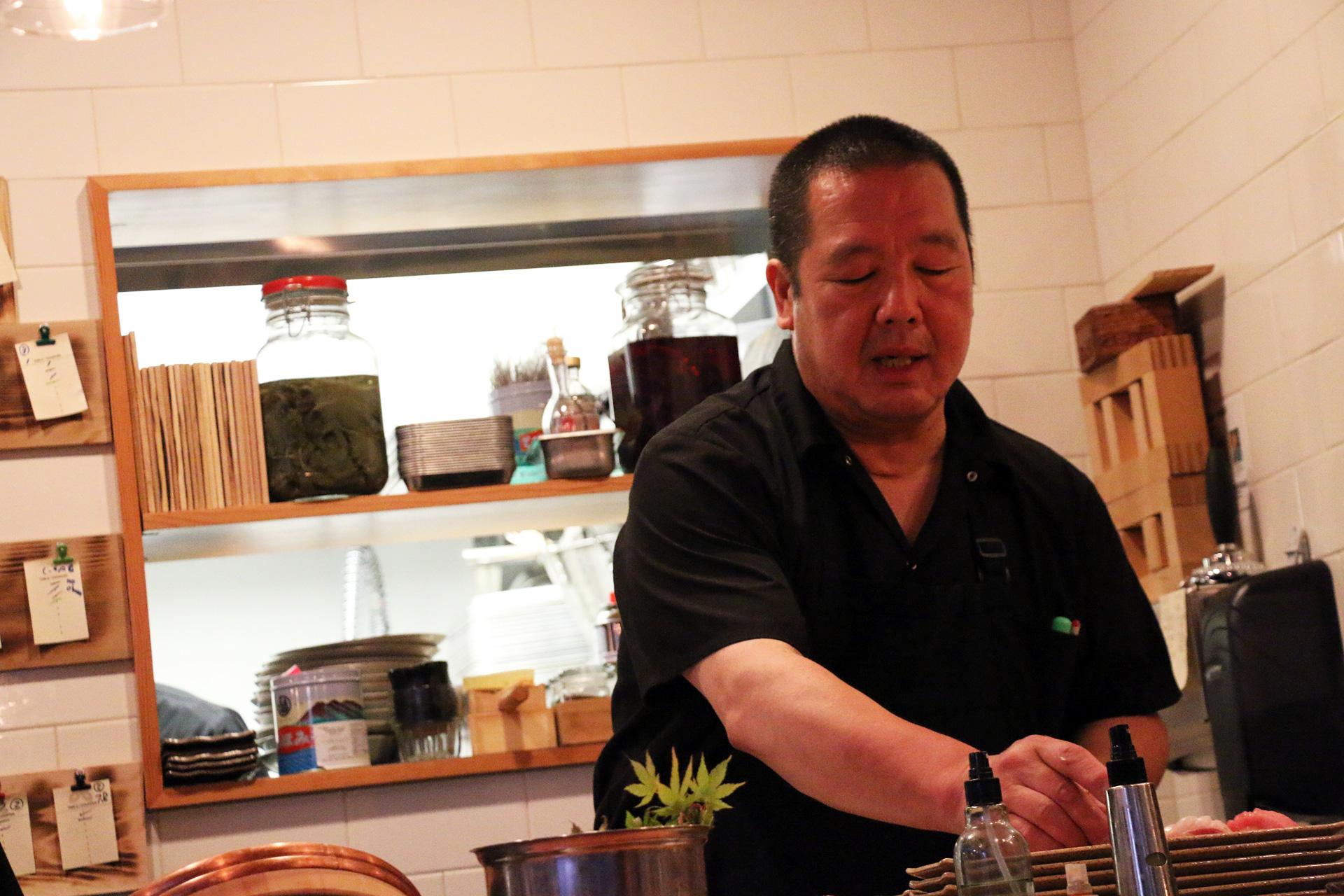 Chef Masa Sasaki behind the sushi bar at Delage.
