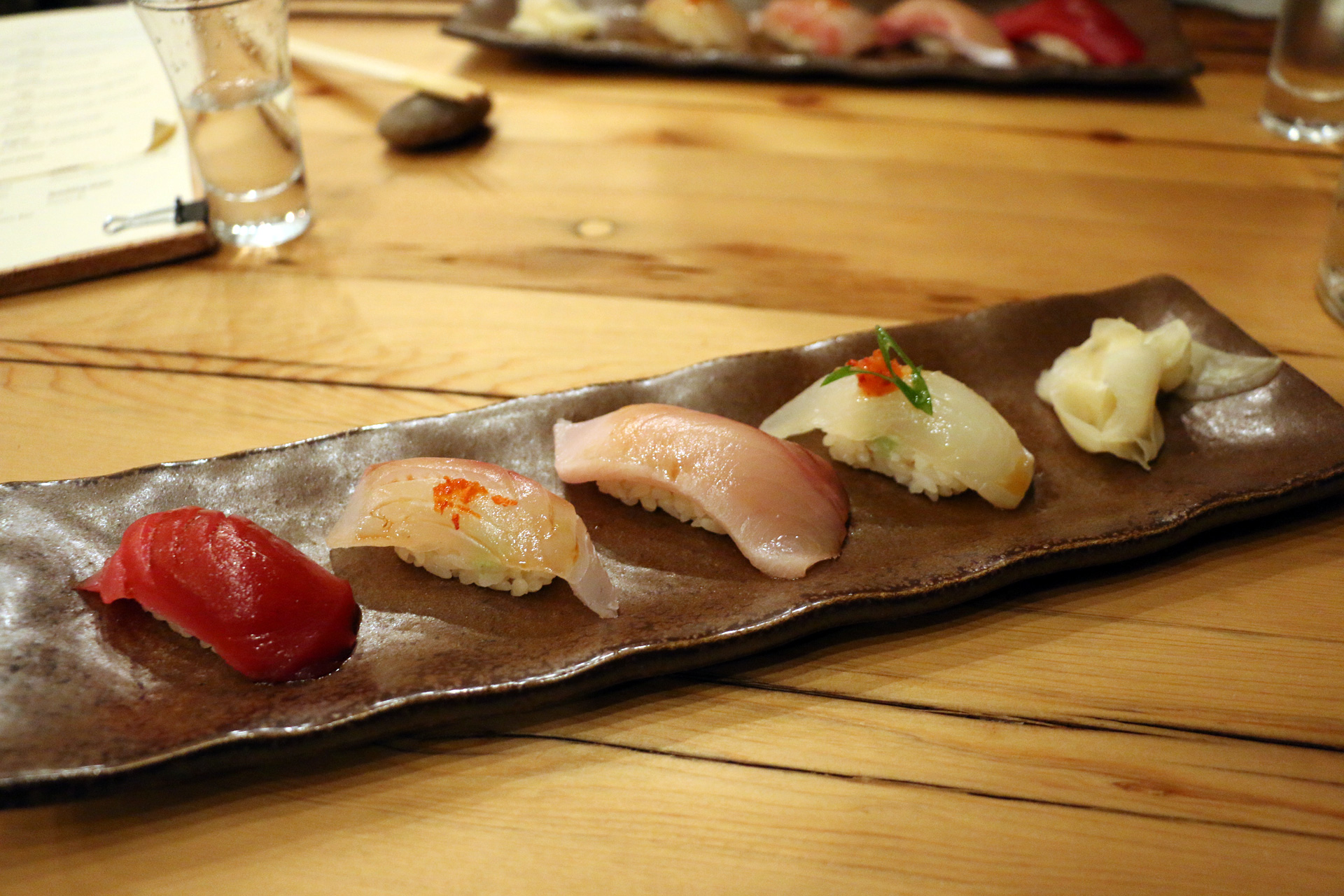 Four pieces of nigiri, the first of two rounds.