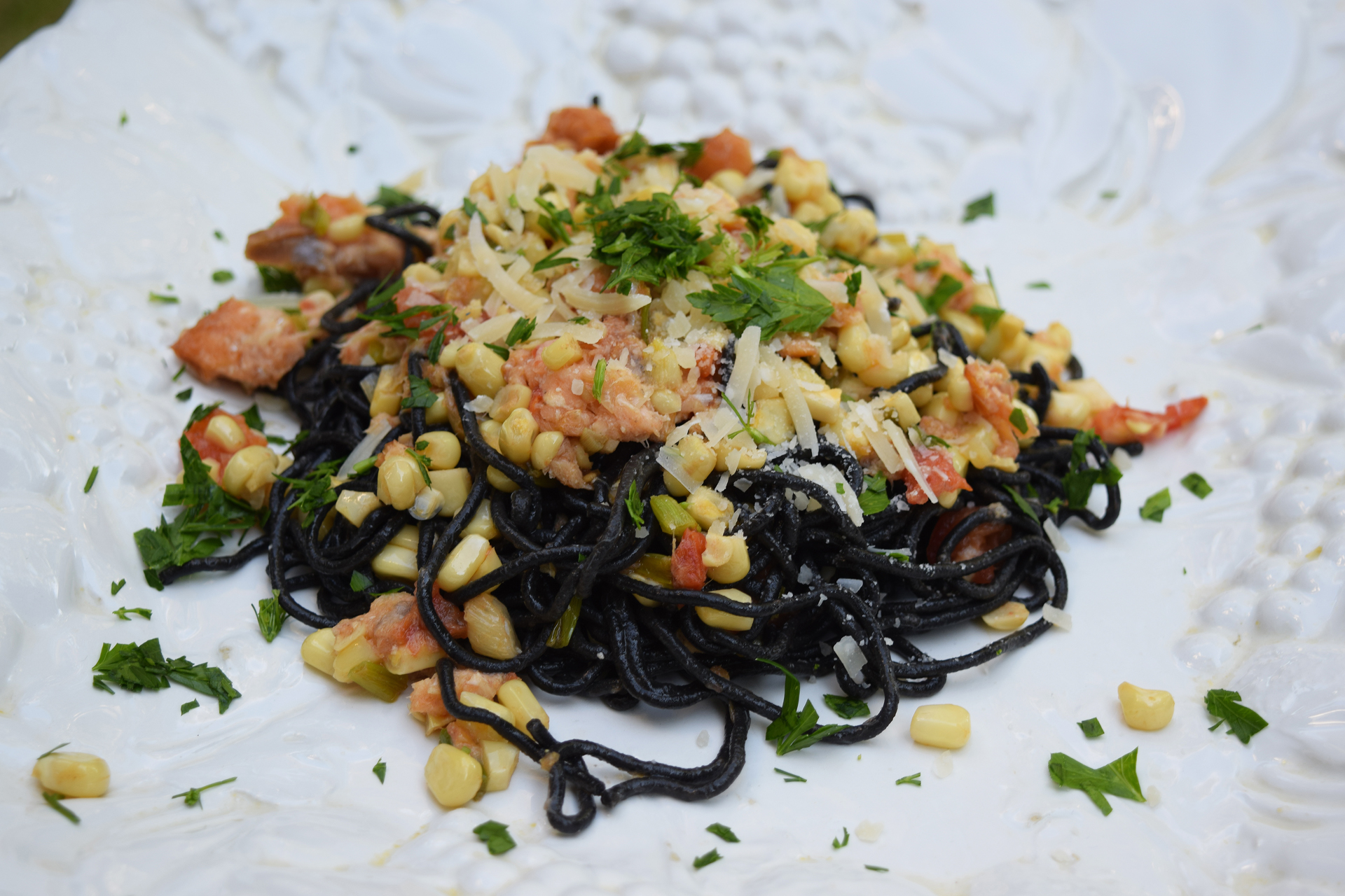 With its faint seashore flavors, the squid ink linguine from Pasta Pasta is great paired with seafood, such as this mélange of corn, tomato, smoked salmon and herbs.