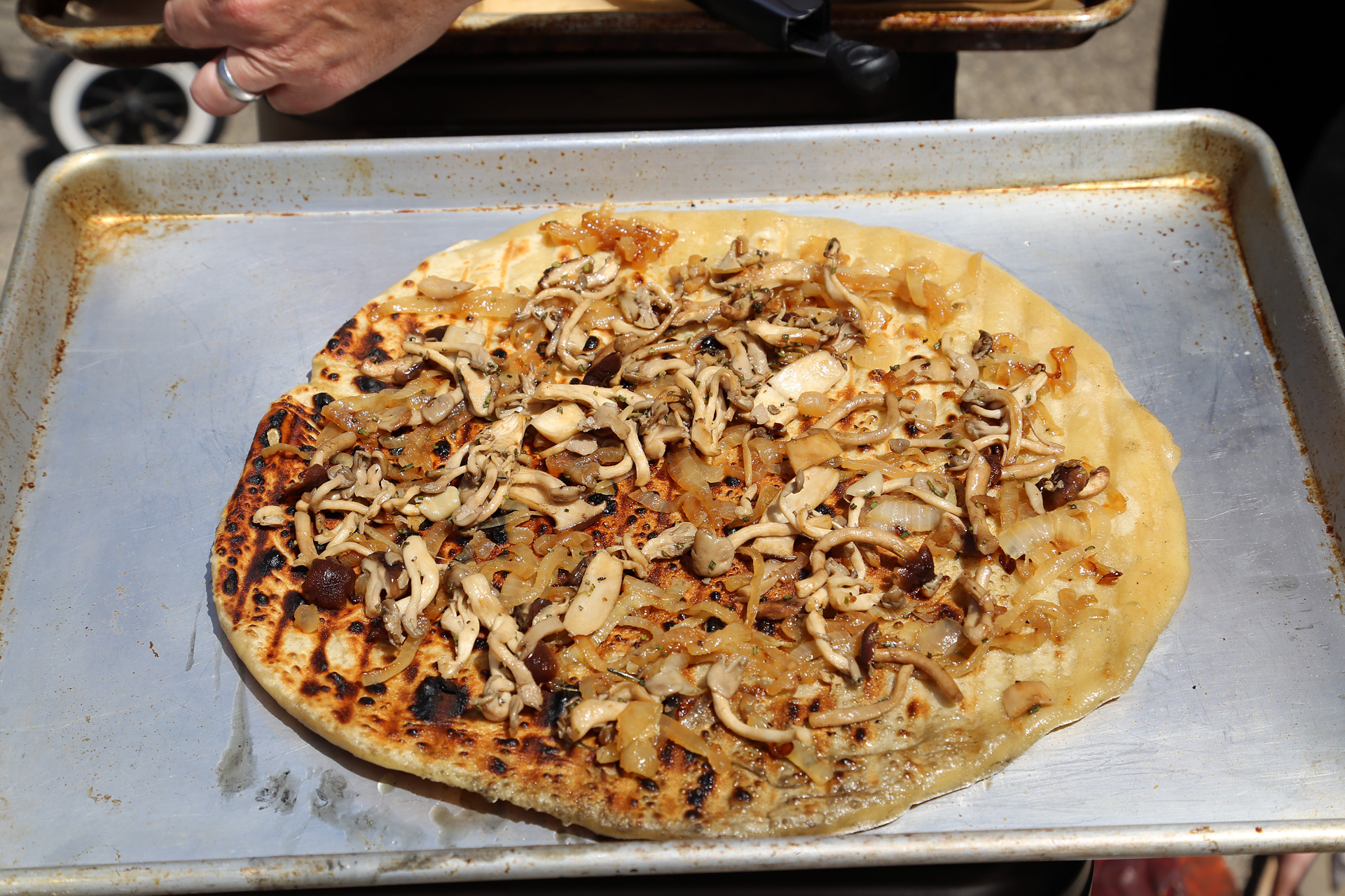 Top the grilled side of the pizza evenly with half the mushroom-onion mixture.