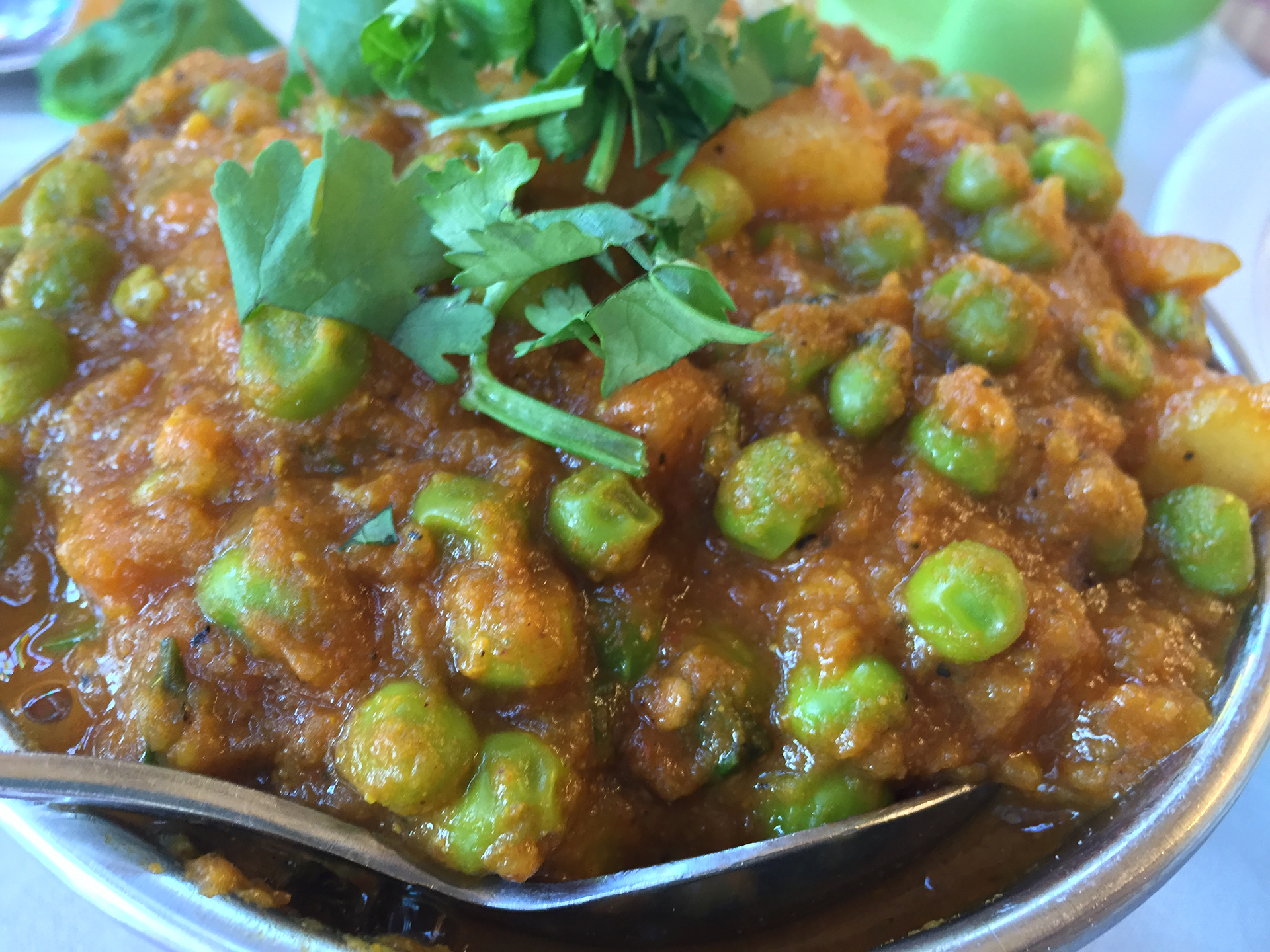 Aloo matar, a sweetly spicy combination of peas and potatoes.