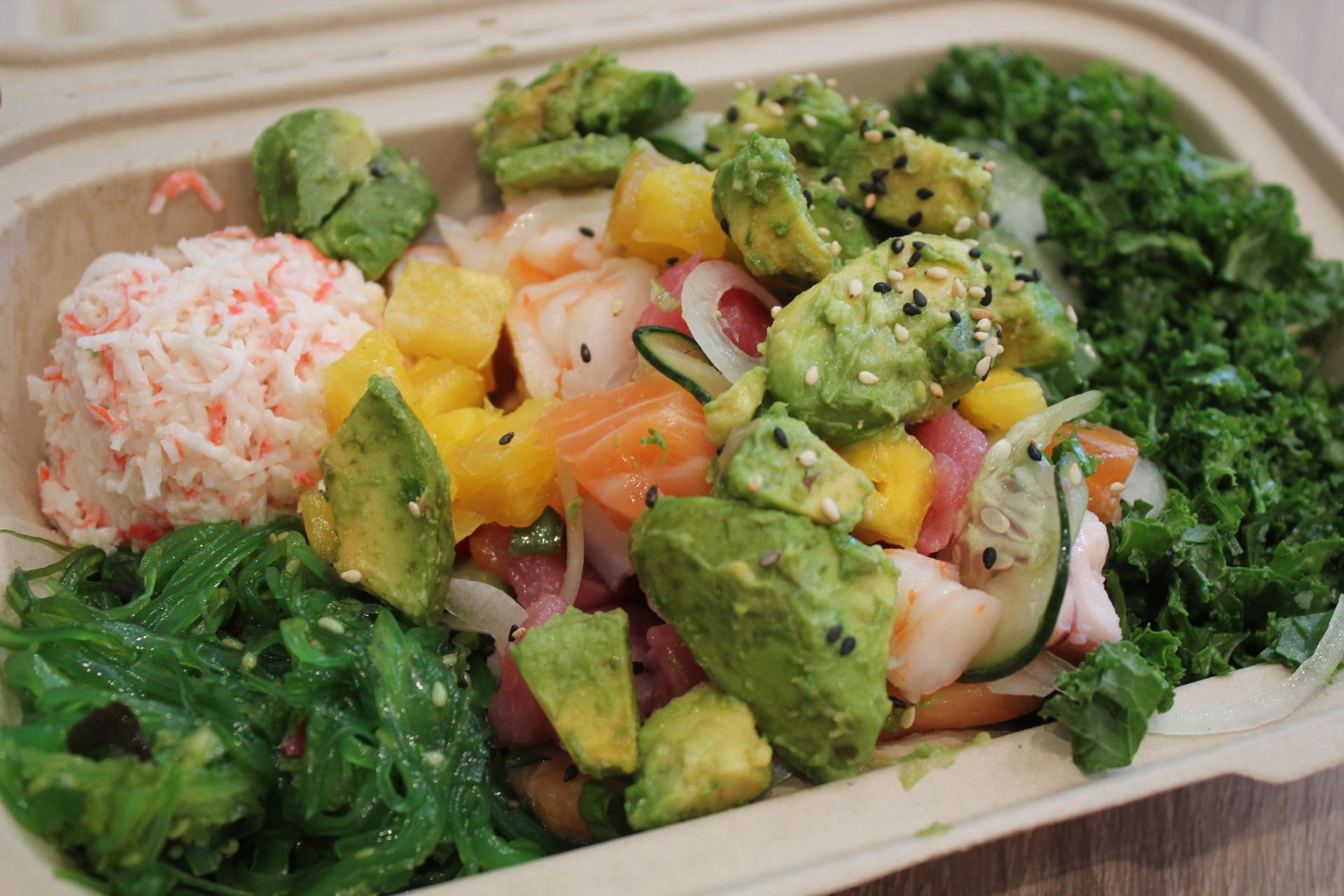 Salmon, ahi tuna and shrimp with mangos over a kale salad.