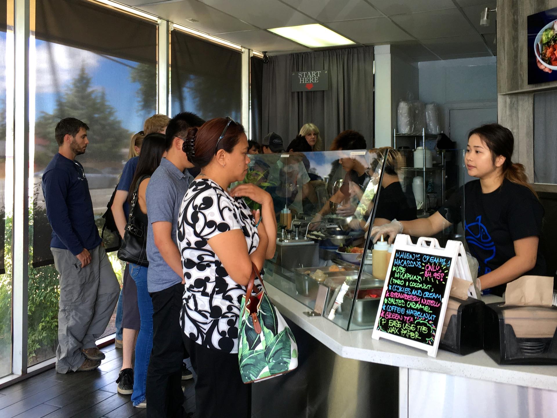 Customers in line at Poki Bowl in San Jose.