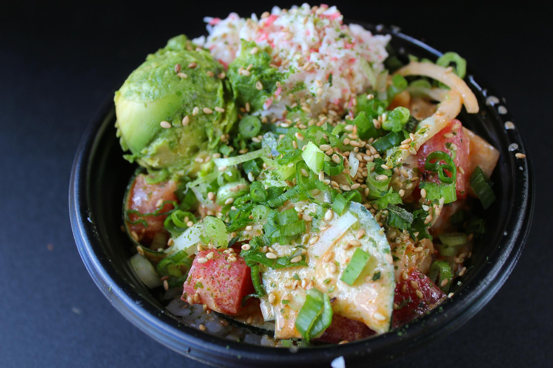 Ahi tuna and yellowtail with cucumbers, green onions, crab salad and avocado at Poki Bowl.
