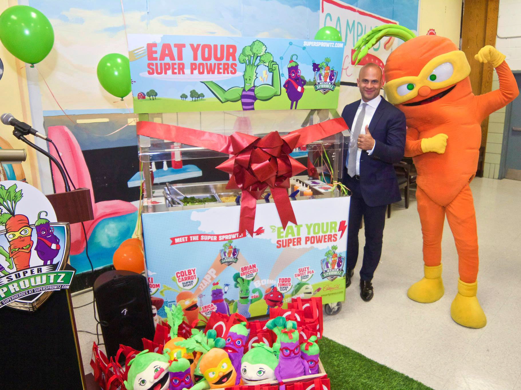 Former White House chef Sam Kass and Colby Carrot at a salad bar launch in New York City.