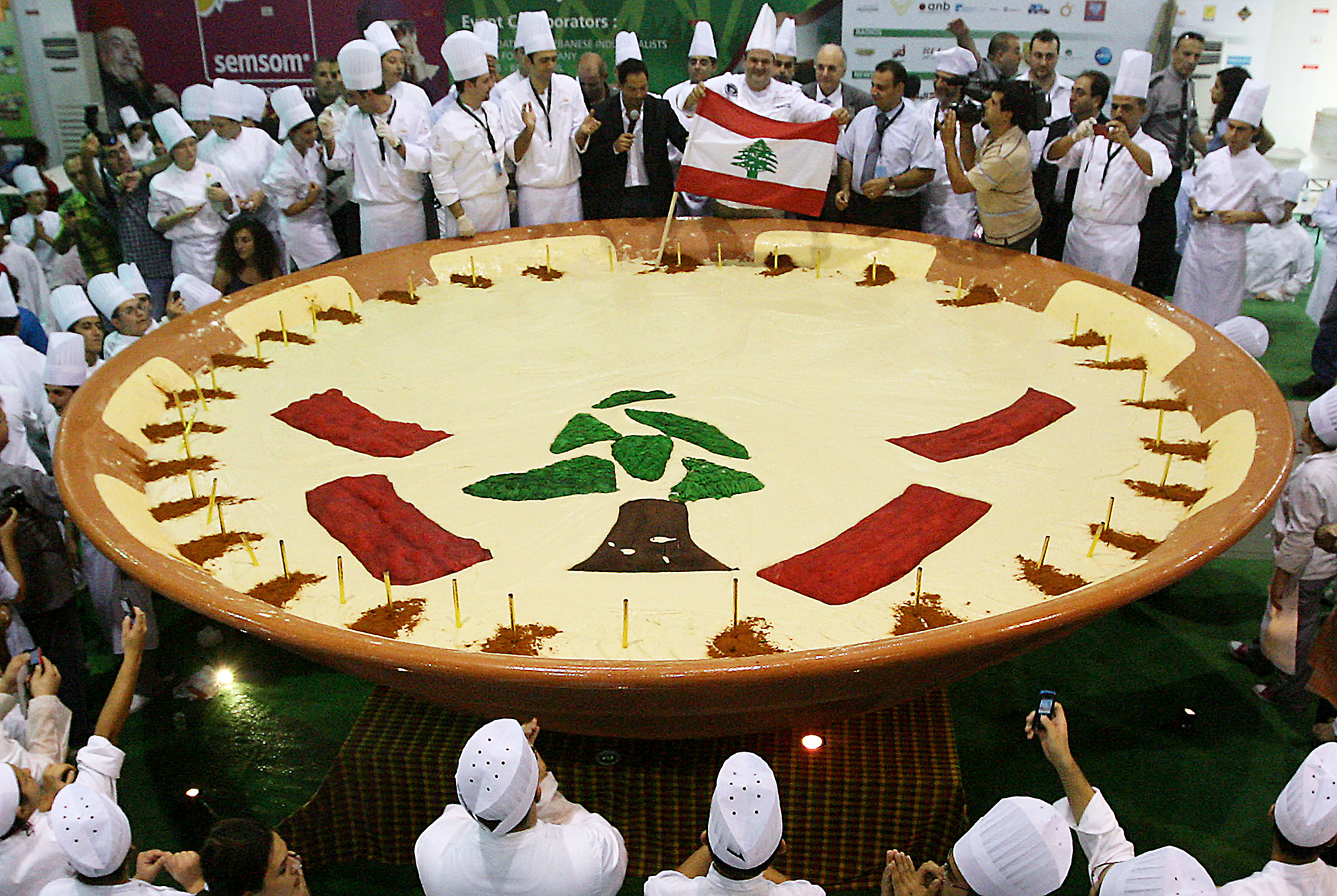 Lebanese chefs celebrate in Beirut after setting a new Guinness record for what was then the biggest tub of hummus in the world — weighing over 2 tons — in October 2009. The world record effort was part of Lebanon's bid to claim hummus as its own.