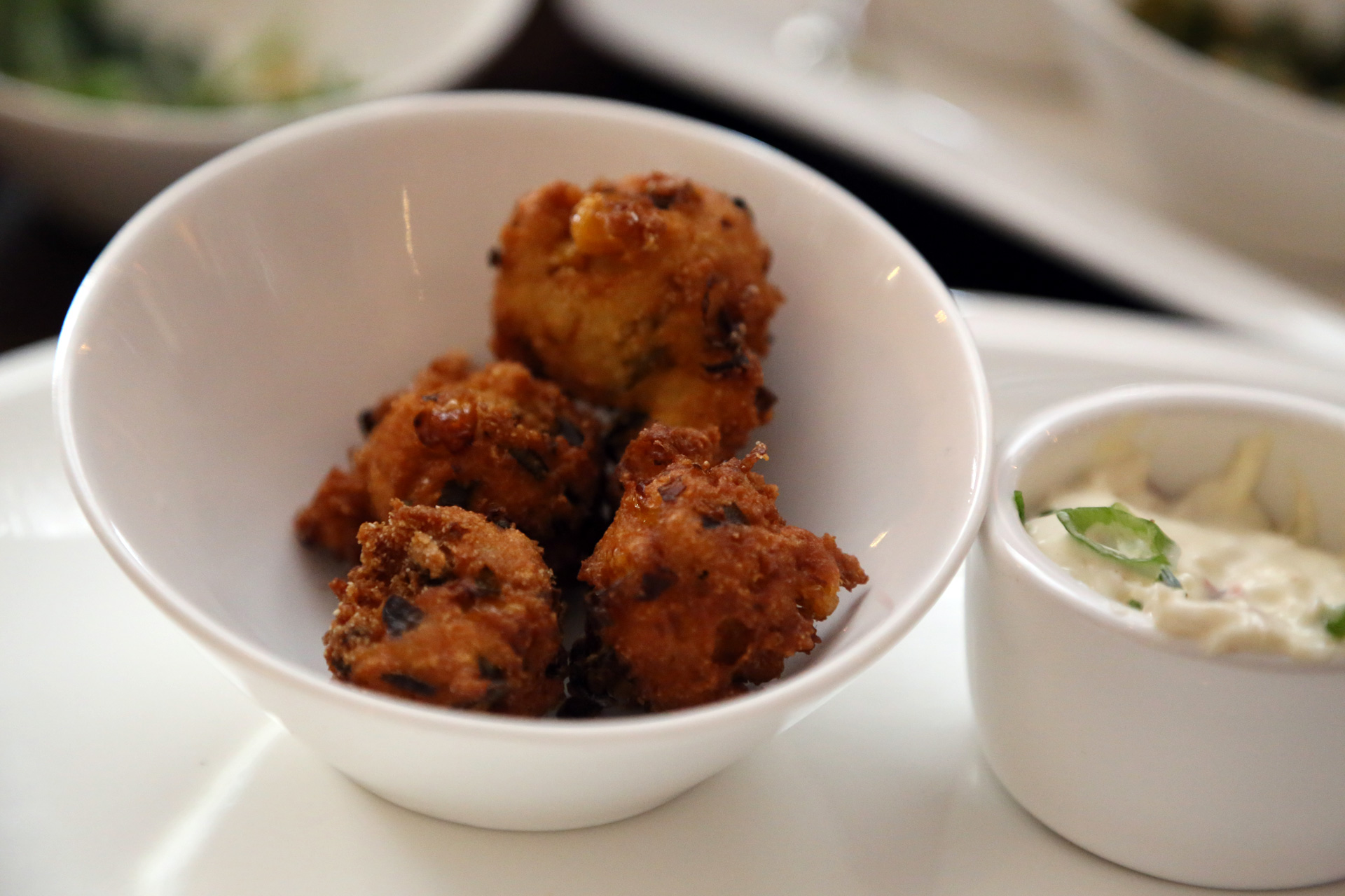 Corn and Smoked Chili Hush Puppies at Scopo Divino