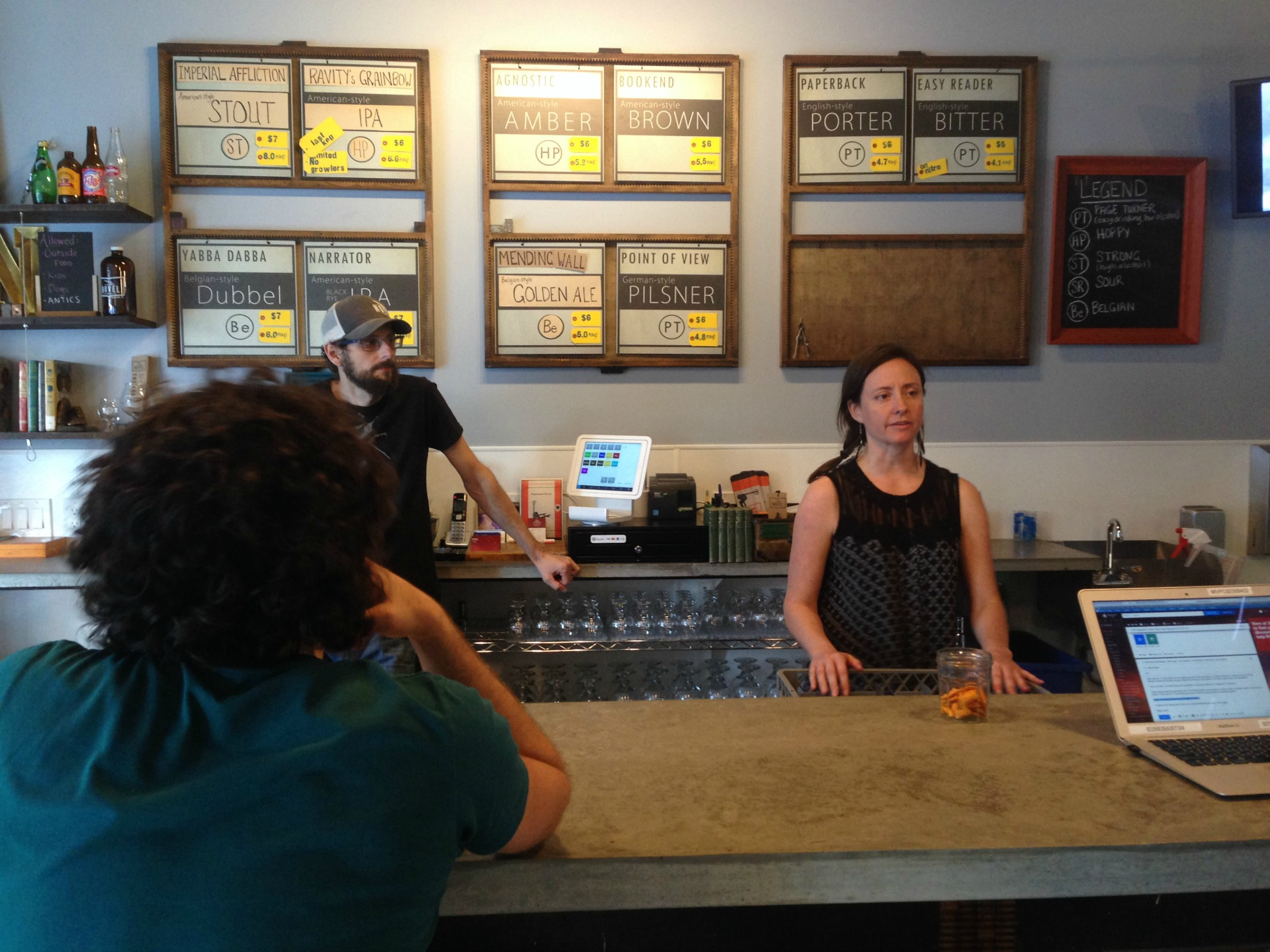 Novel Brewing owners Brian Koloszyc and Teresa Tamburello working the bar.