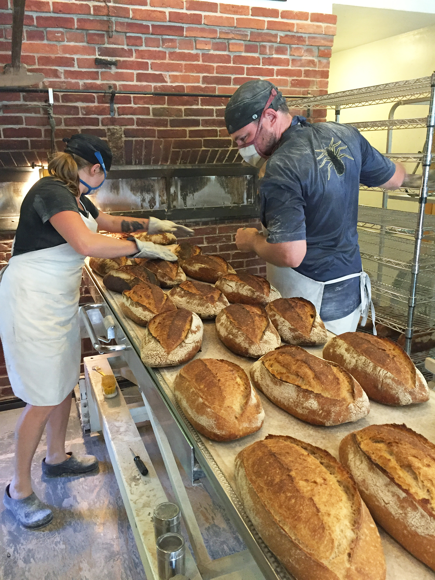 Blair Marvin working with the head baker at Elmore Mountain Bread.
