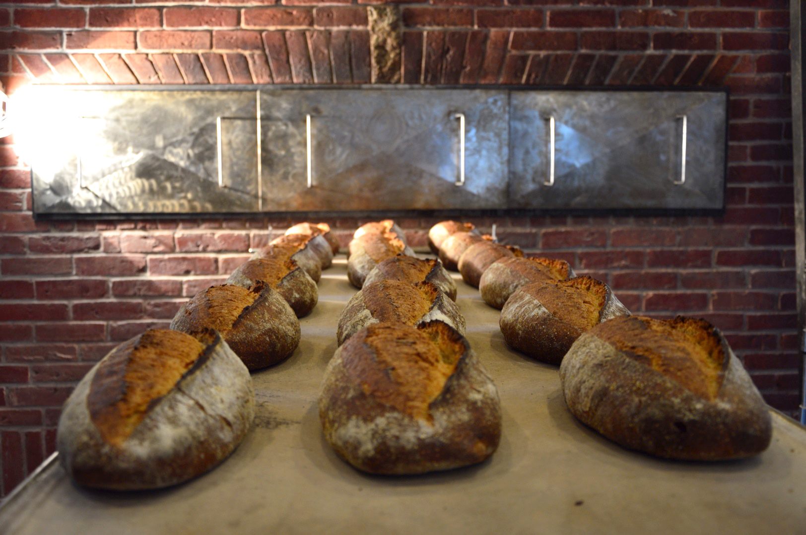 Breads baked at the Elmore Mountain Bread use freshly stone milled flour.