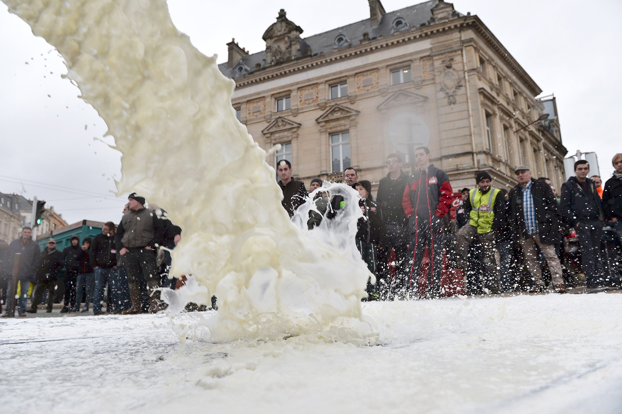 To protest against the falling prices of dairy and meat, farmers pour liters of milk in front of a prefecture in northwestern France in January.