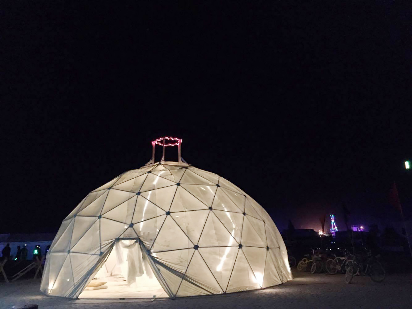 Milk and Honey's geodesic dome at night.