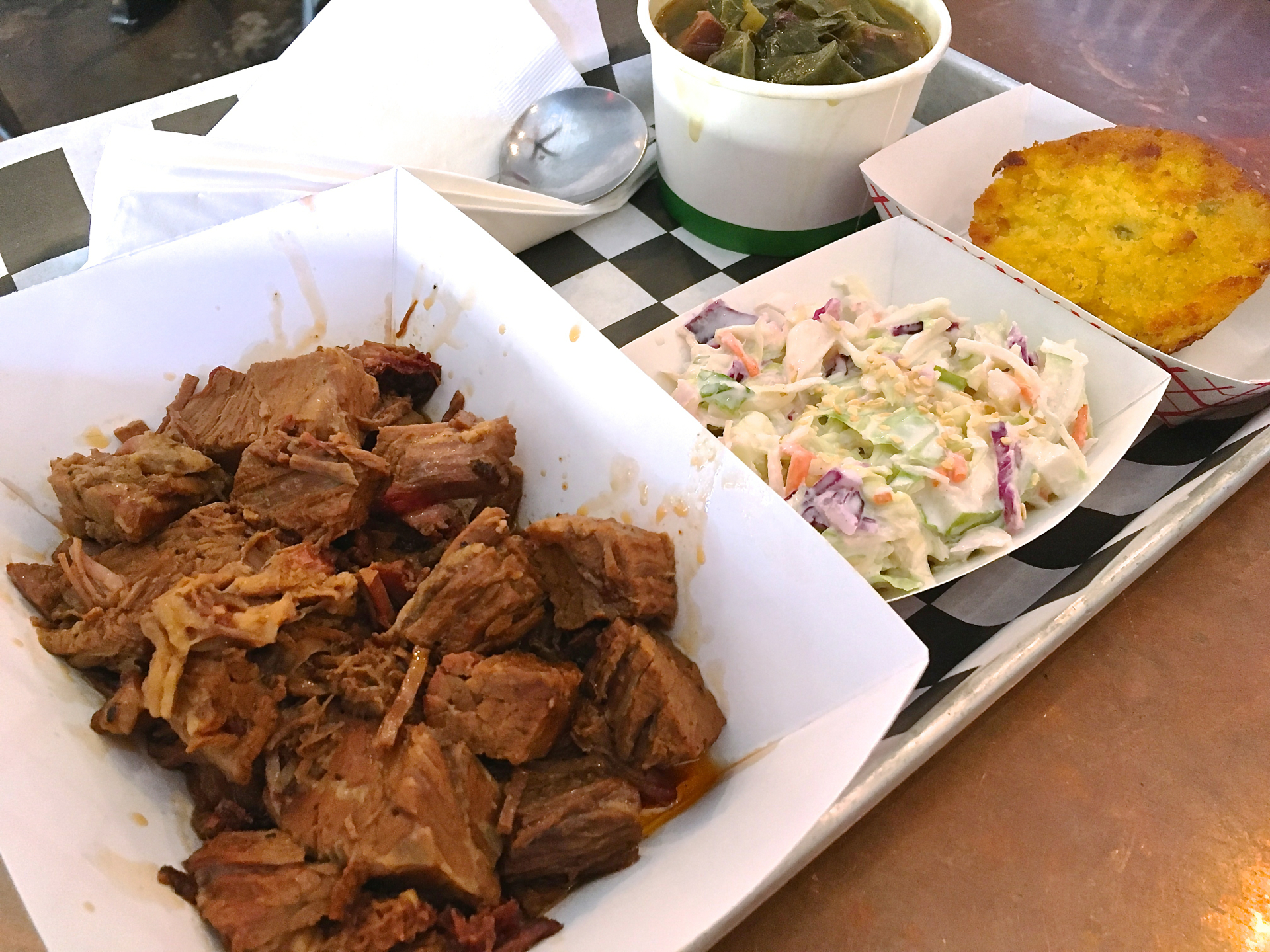 The chopped brisket tray with coleslaw, cornbread and collard greens.