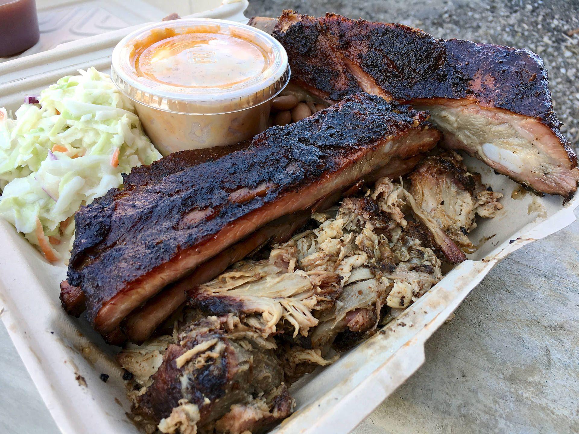 A combination plate with ribs and pulled pork at Gorilla BBQ.