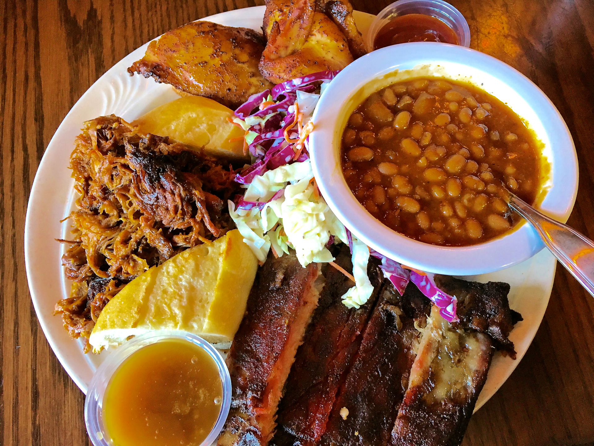 A combination plate with ribs, roasted chicken and pulled pork at The Cats.