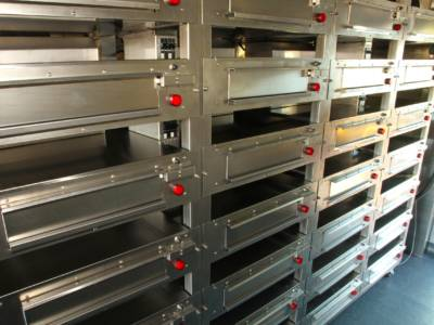 The racks lock into place so the ovens stay still while the delivery truck is driving.