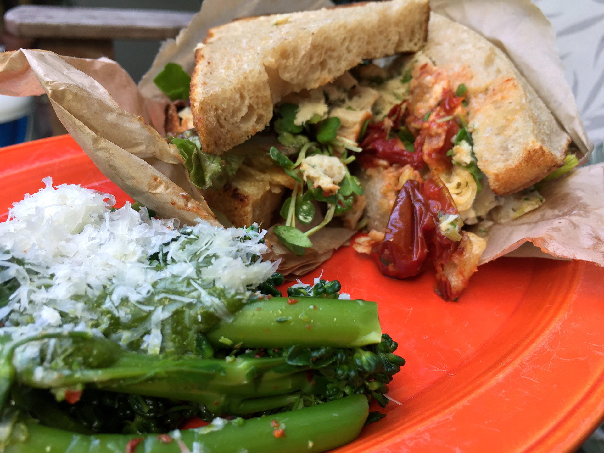 Poached local albacore sandwich on Josey Baker bread with a side of broccoli rabe with chermoula dressing