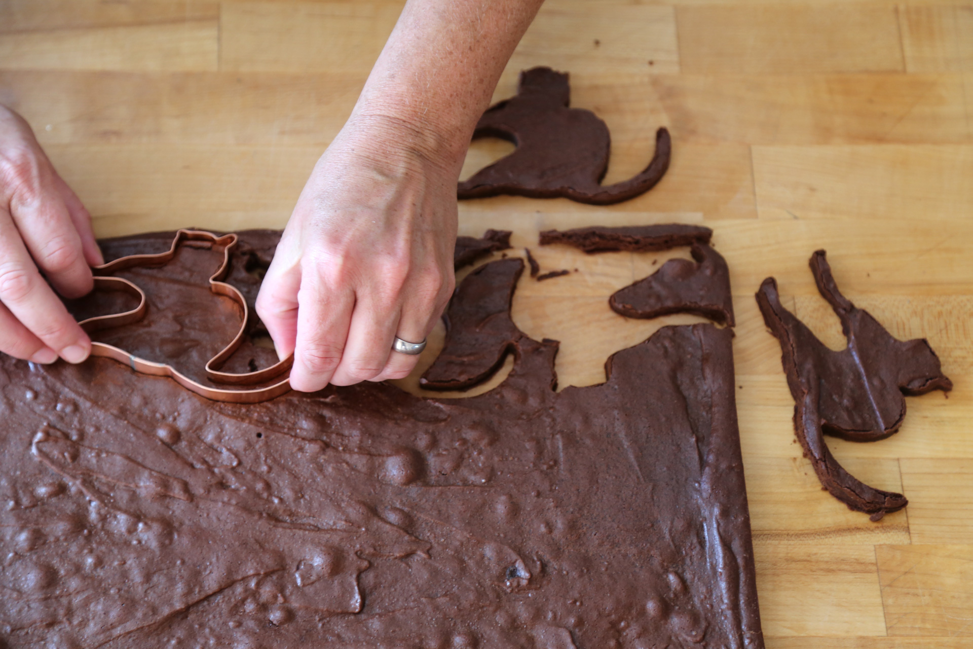 Using your favorite shaped cookie cutter, cut out as many brownie cookies as possible.
