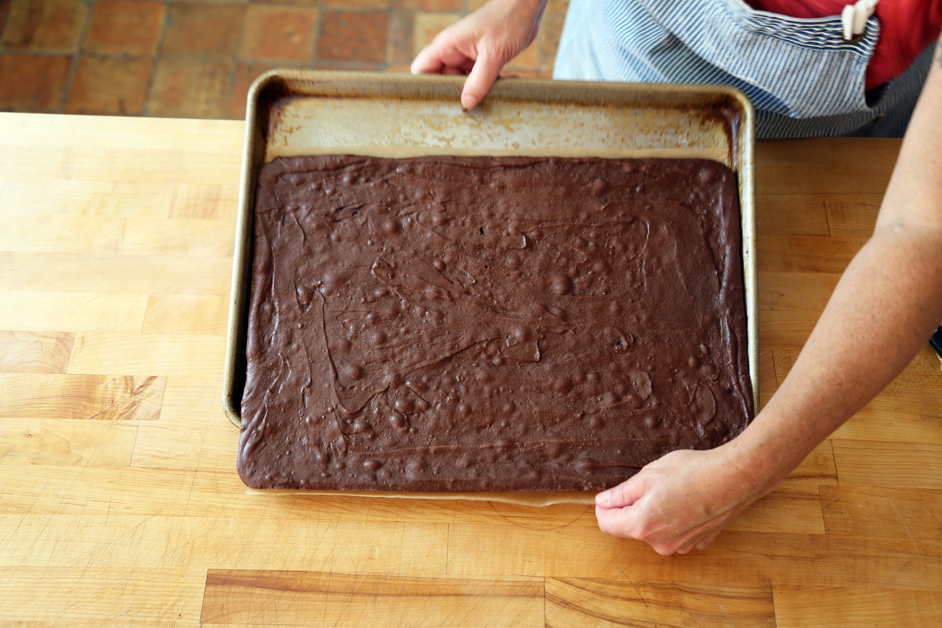 When cool, slide the brownie onto a work surface.